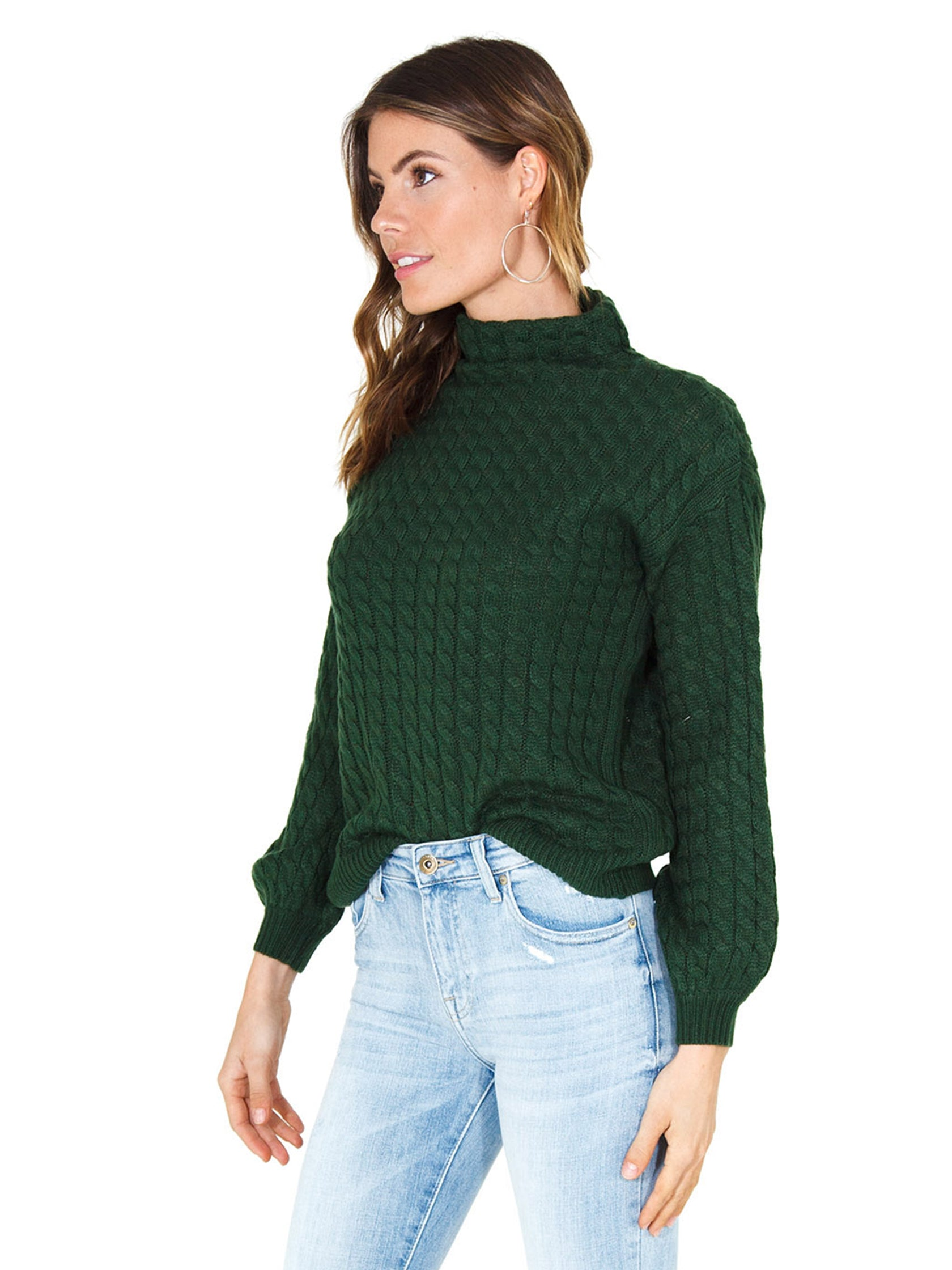 Women wearing a sweater rental from Line & Dot called Juniper Cable Knit Sweater