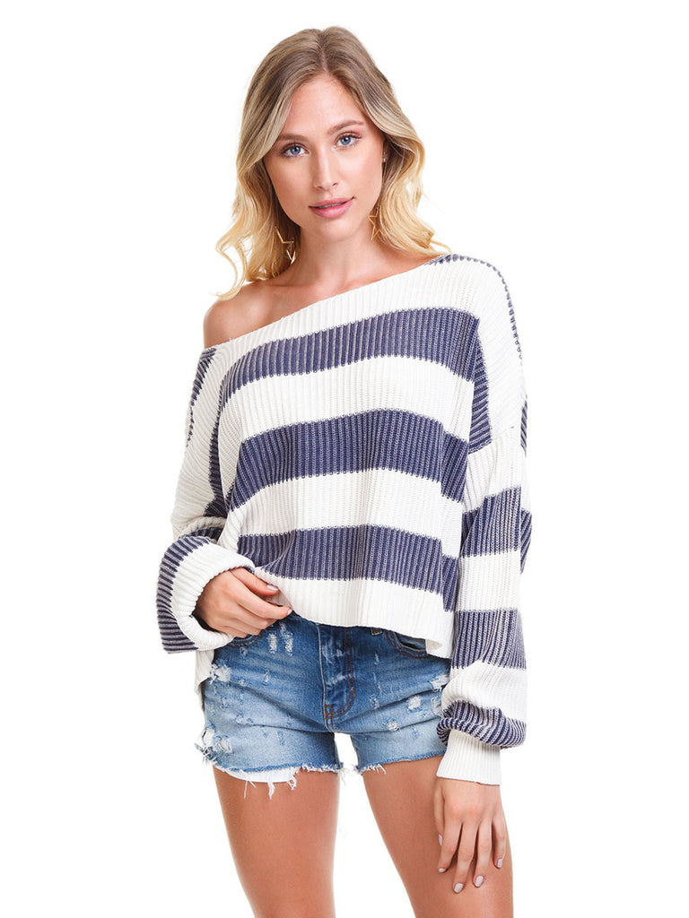 Woman wearing a sweater rental from Free People called Adella Bralette