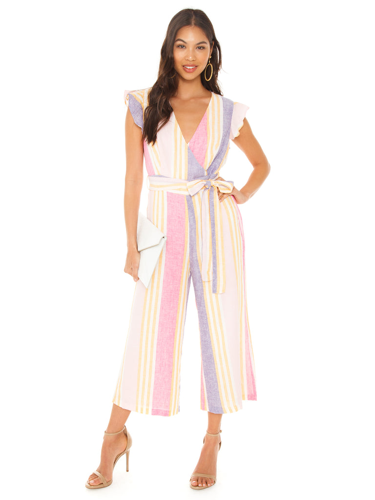 Woman wearing a jumpsuit rental from Line & Dot called Elsie Ruffle Wrap Dress