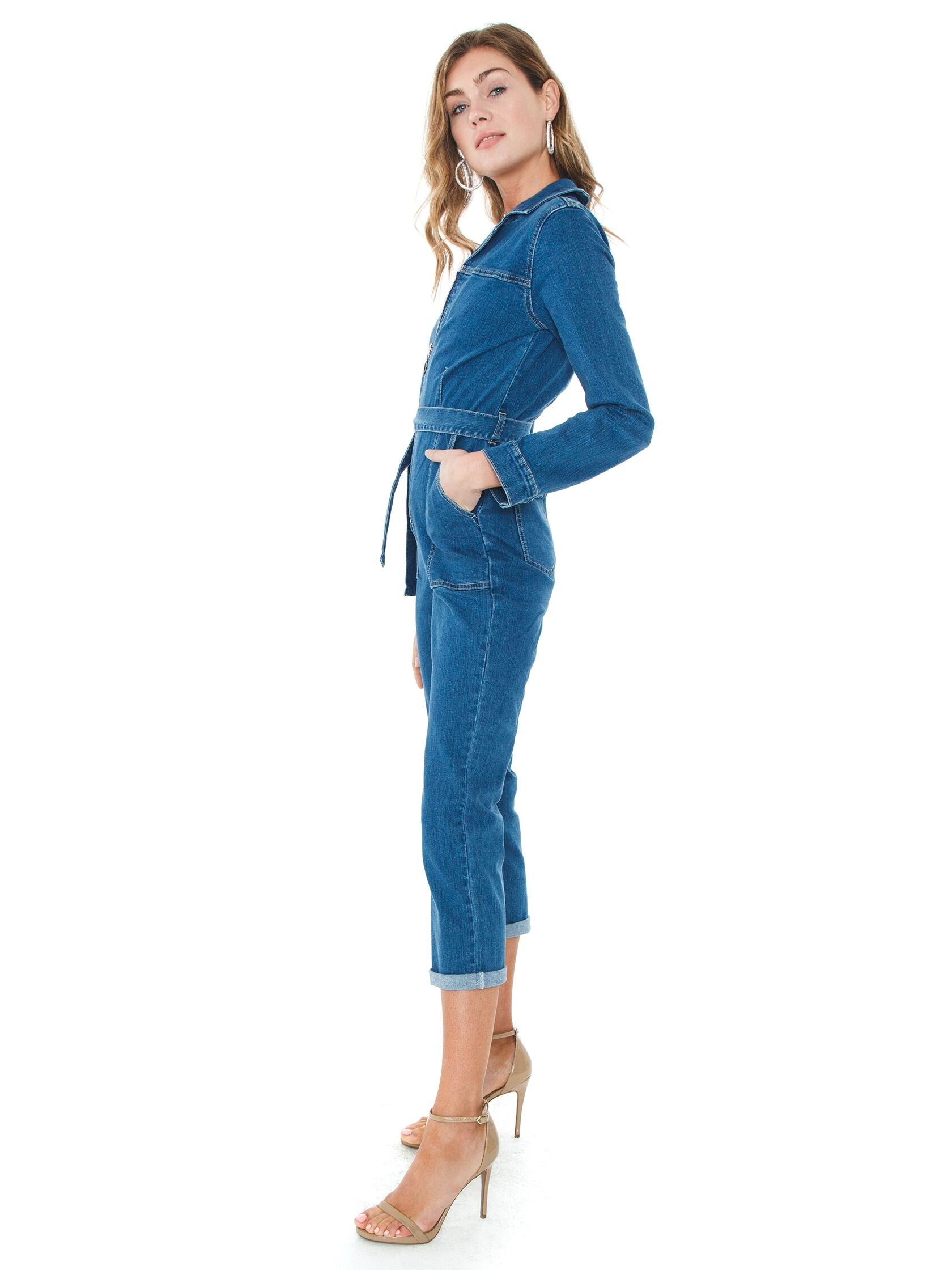 Woman wearing a jumpsuit rental from MINKPINK called Keeping Time Boiler Suit