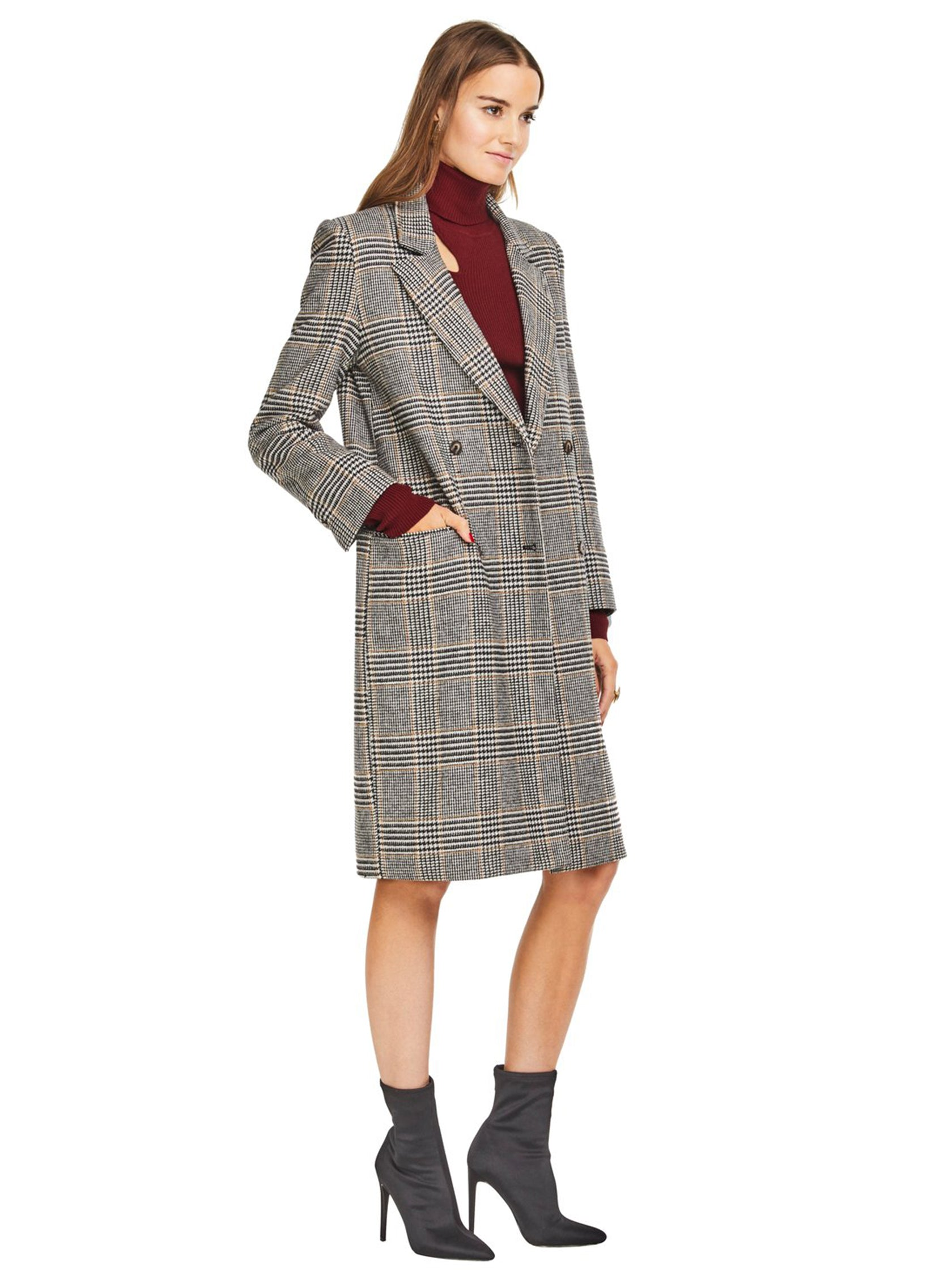 Woman wearing a jacket rental from ASTR called Kensington Coat