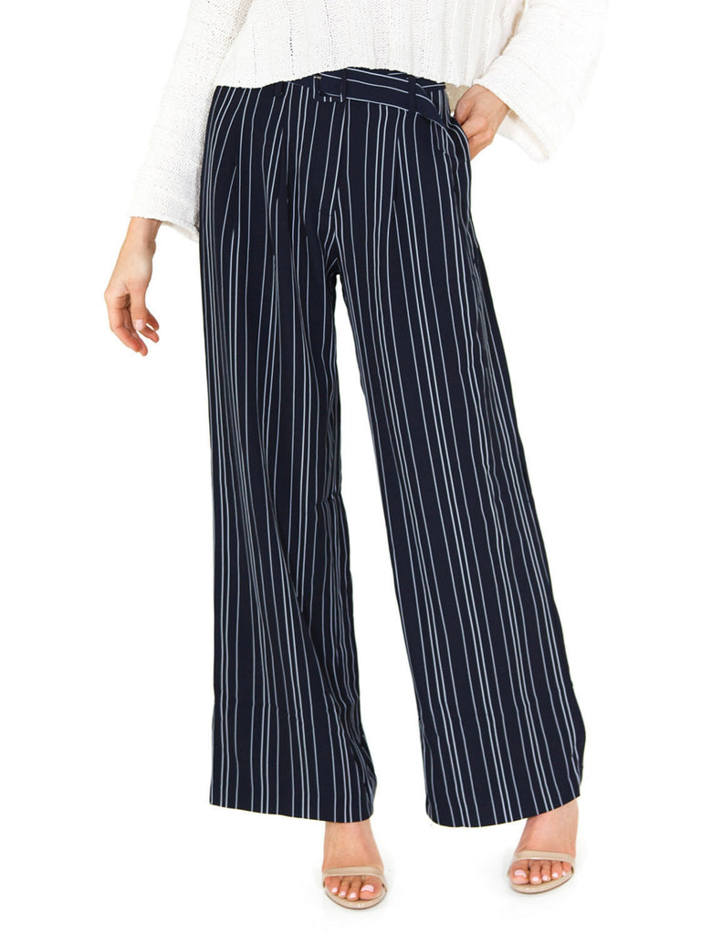 Women wearing a bottoms rental from WAYF called Campbell High Slit Pants