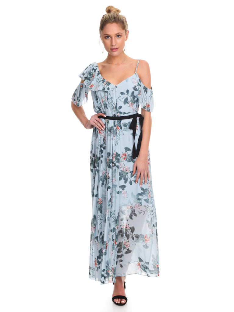Girl wearing a dress rental from French Connection called Abby Off Shoulder Tiered Maxi Dress