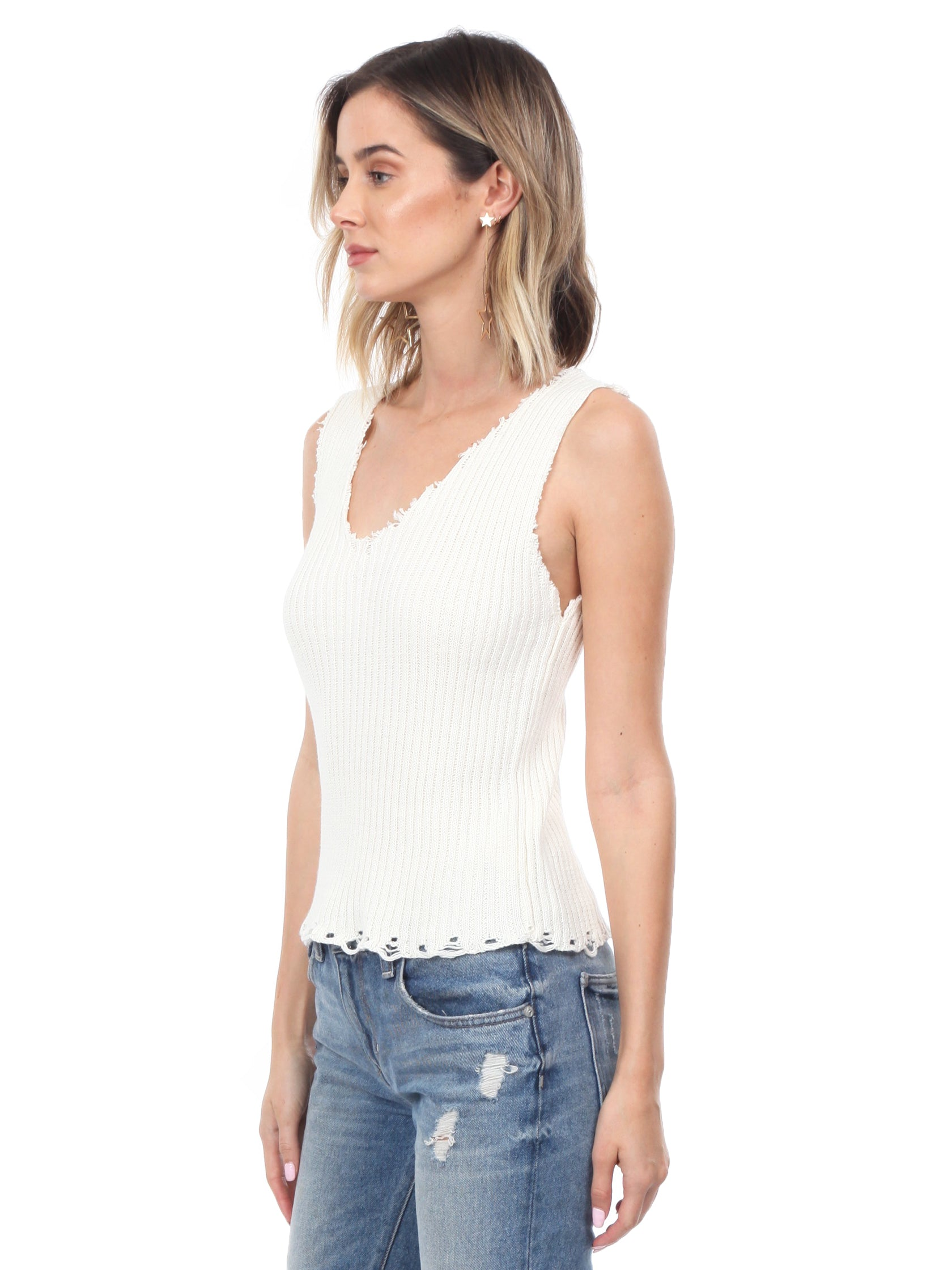 Women wearing a top rental from Moon River called Knit Sleeveless Sweater Top