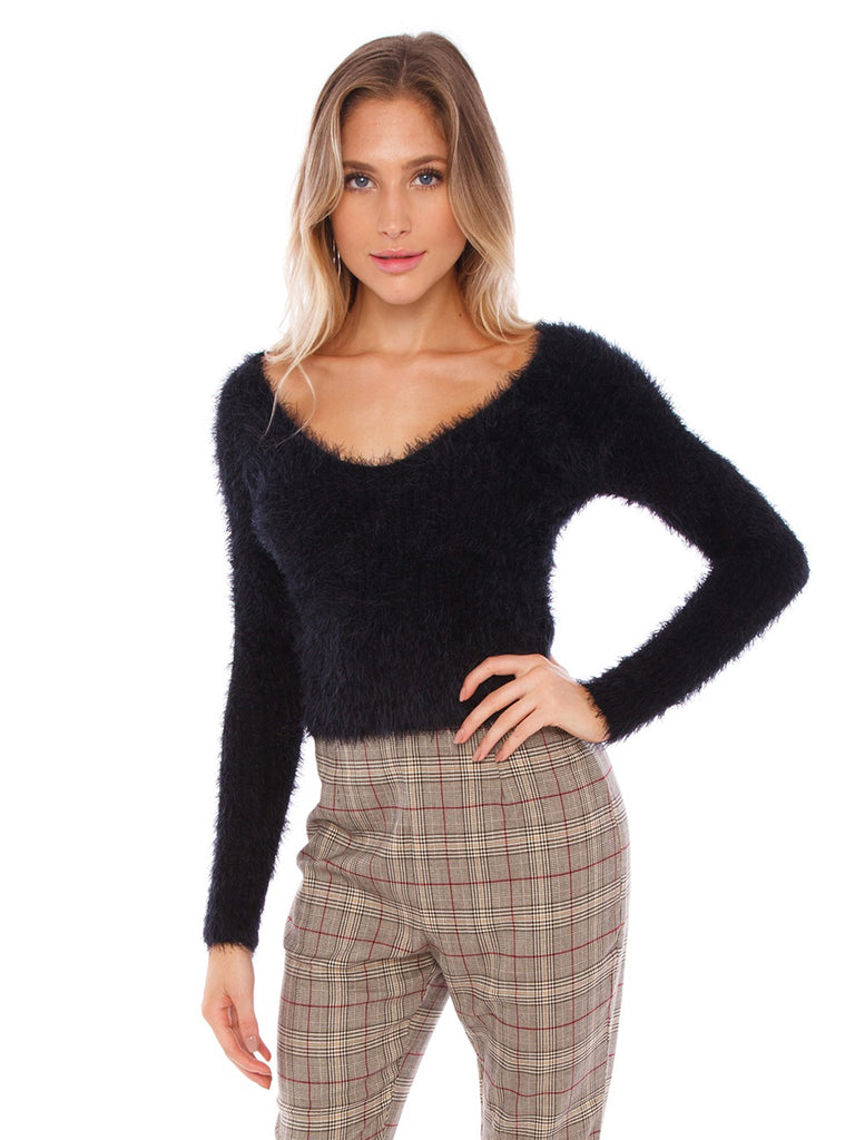 Woman wearing a sweater rental from ASTR called Raye Skirt