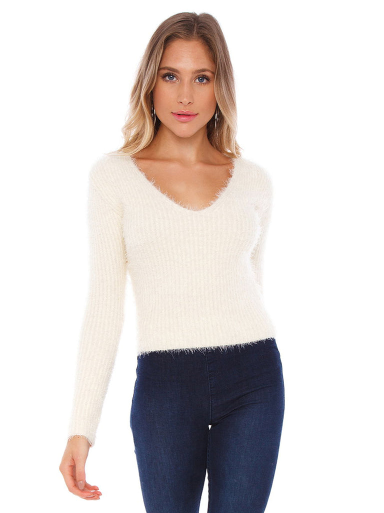 Woman wearing a sweater rental from ASTR called Carly Sweater