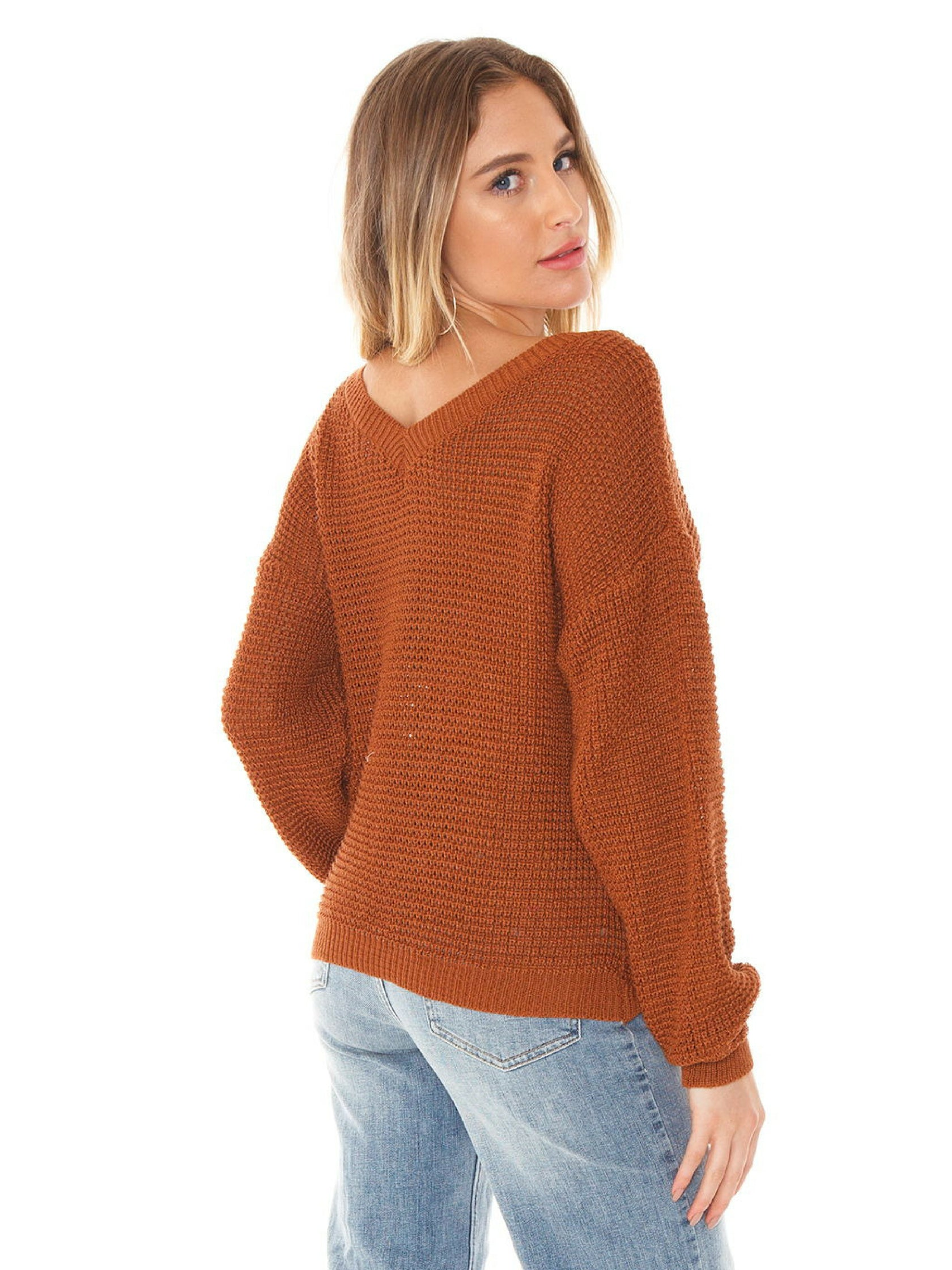 Women outfit in a sweater rental from FASHIONPASS called Kylie Twist Front Sweater