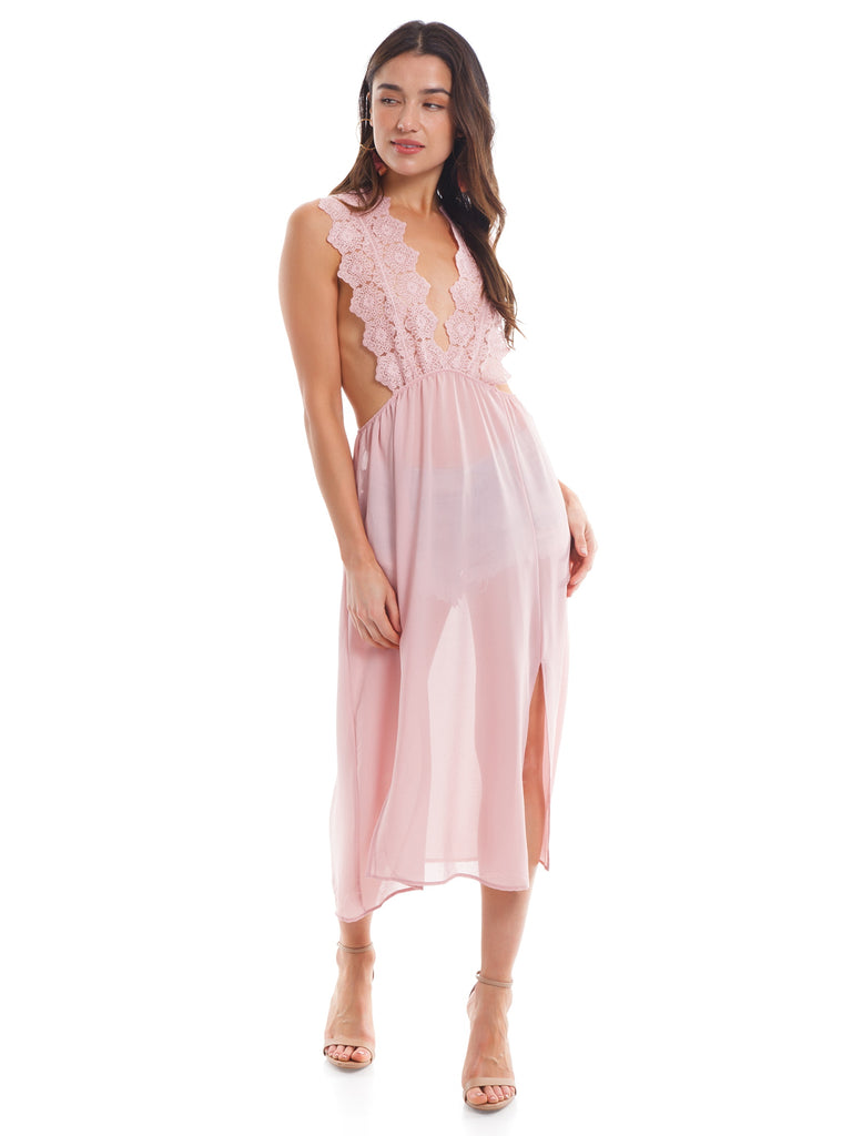 Women wearing a dress rental from Sadie & Sage called Off Shoulder Babydoll Jumpsuit