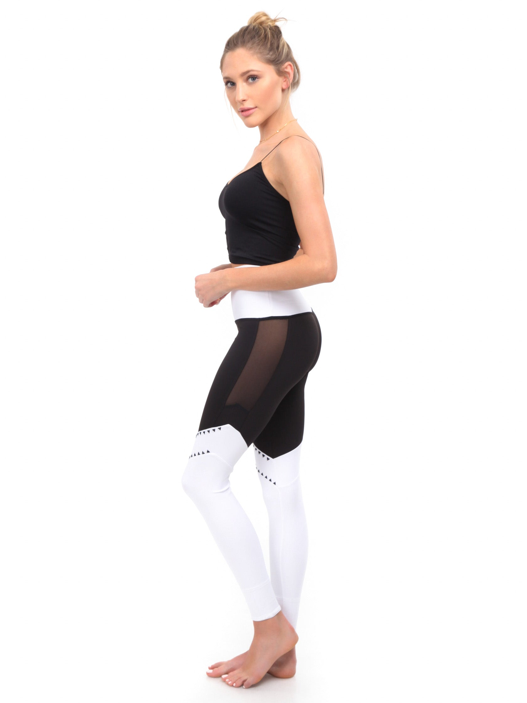 Woman wearing a leggings rental from BEACH RIOT called Lacy Legging