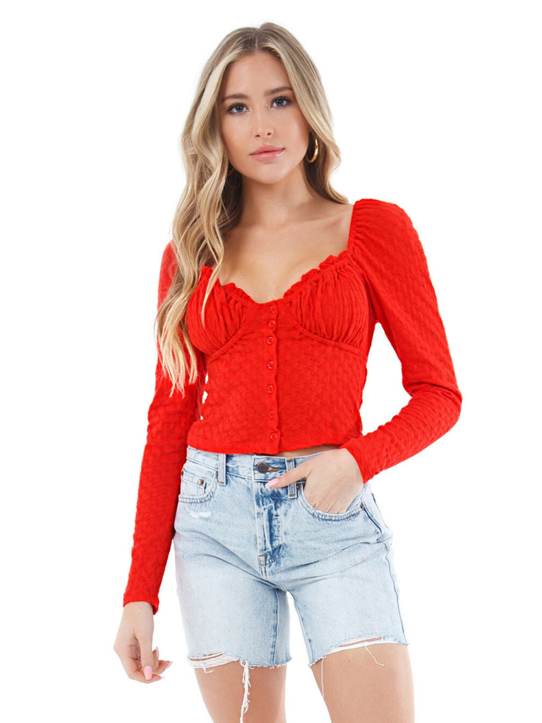 Woman wearing a top rental from Free People called Red Zebra Knit