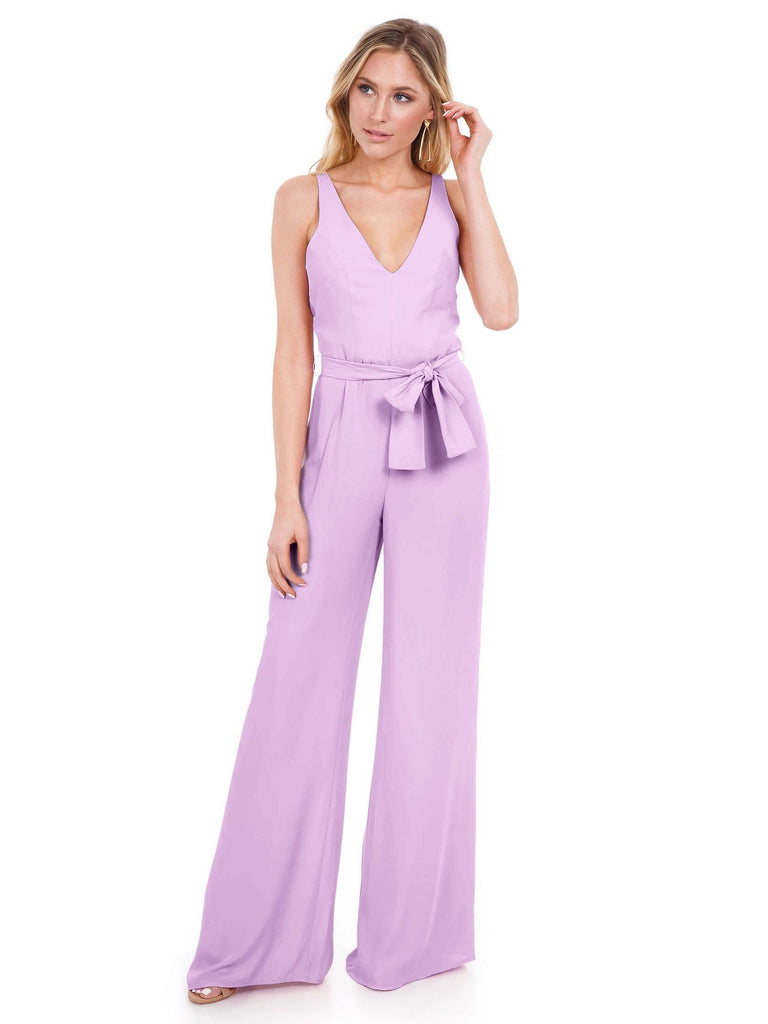 Woman wearing a jumpsuit rental from Amanda Uprichard called Mandy Dress
