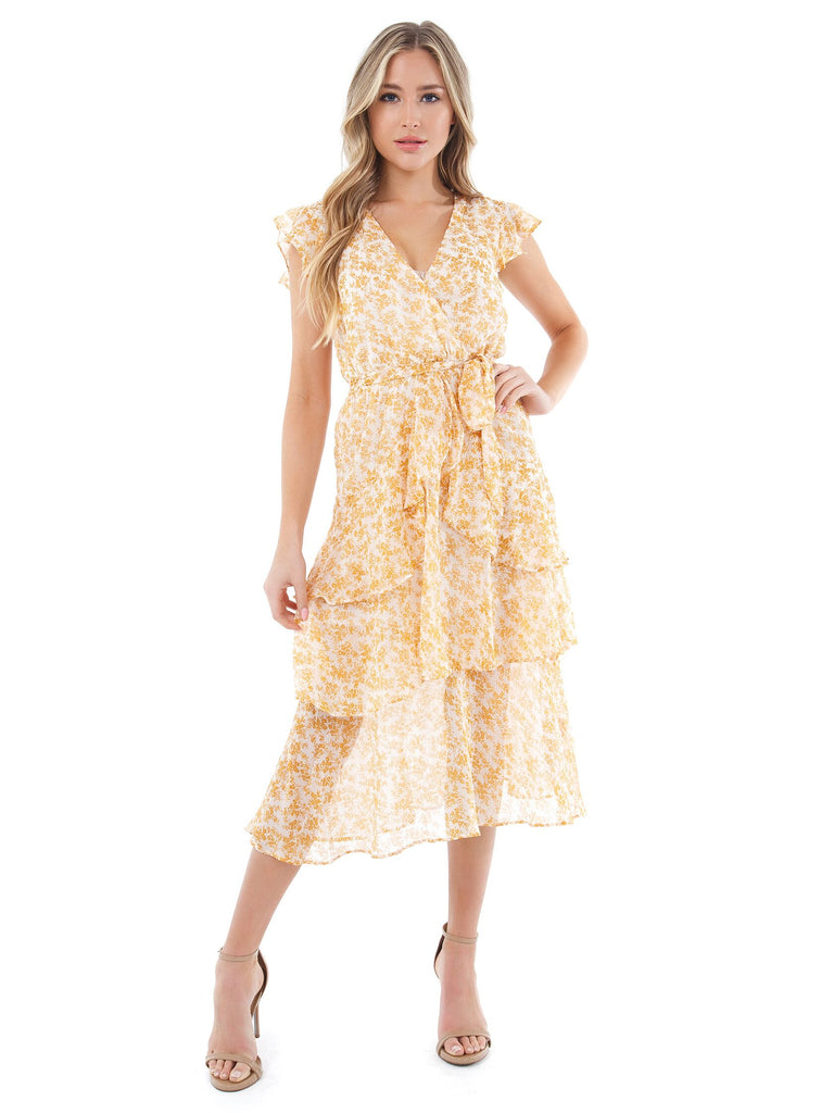 Woman wearing a dress rental from MINKPINK called Dancer Wrap Dress