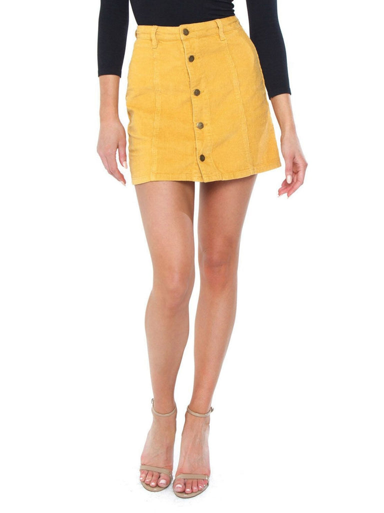 Woman wearing a skirt rental from MINKPINK called Andalusia Tie Front Bodysuit