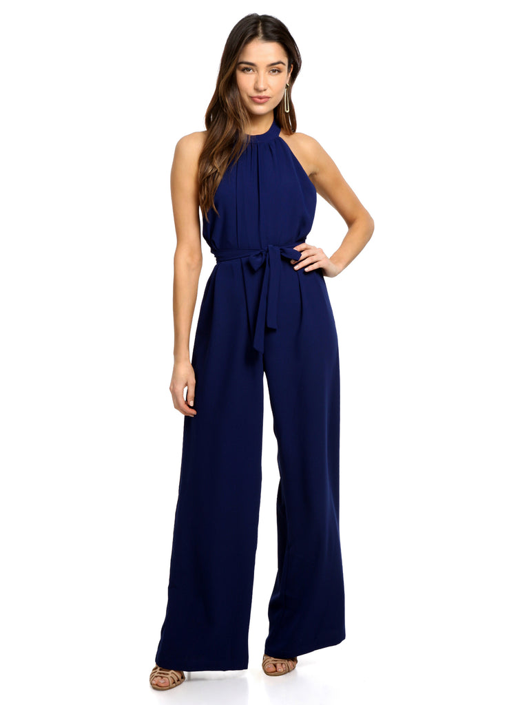 Woman wearing a jumpsuit rental from Amanda Uprichard called Makenna Dress