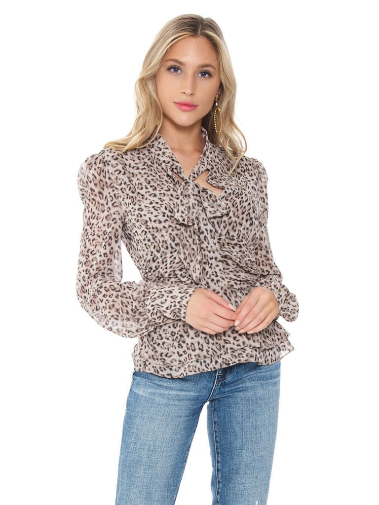 Women wearing a top rental from BARDOT called Leopard Blouse