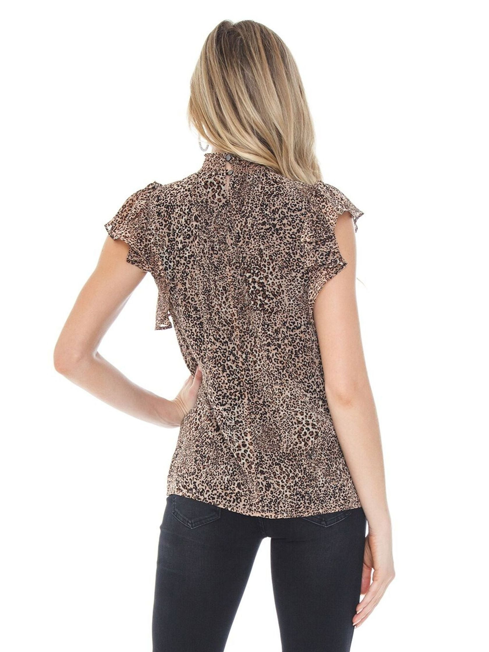Women outfit in a top rental from 1.STATE called Leopard Muse Smocked Neck Keyhole Blouse