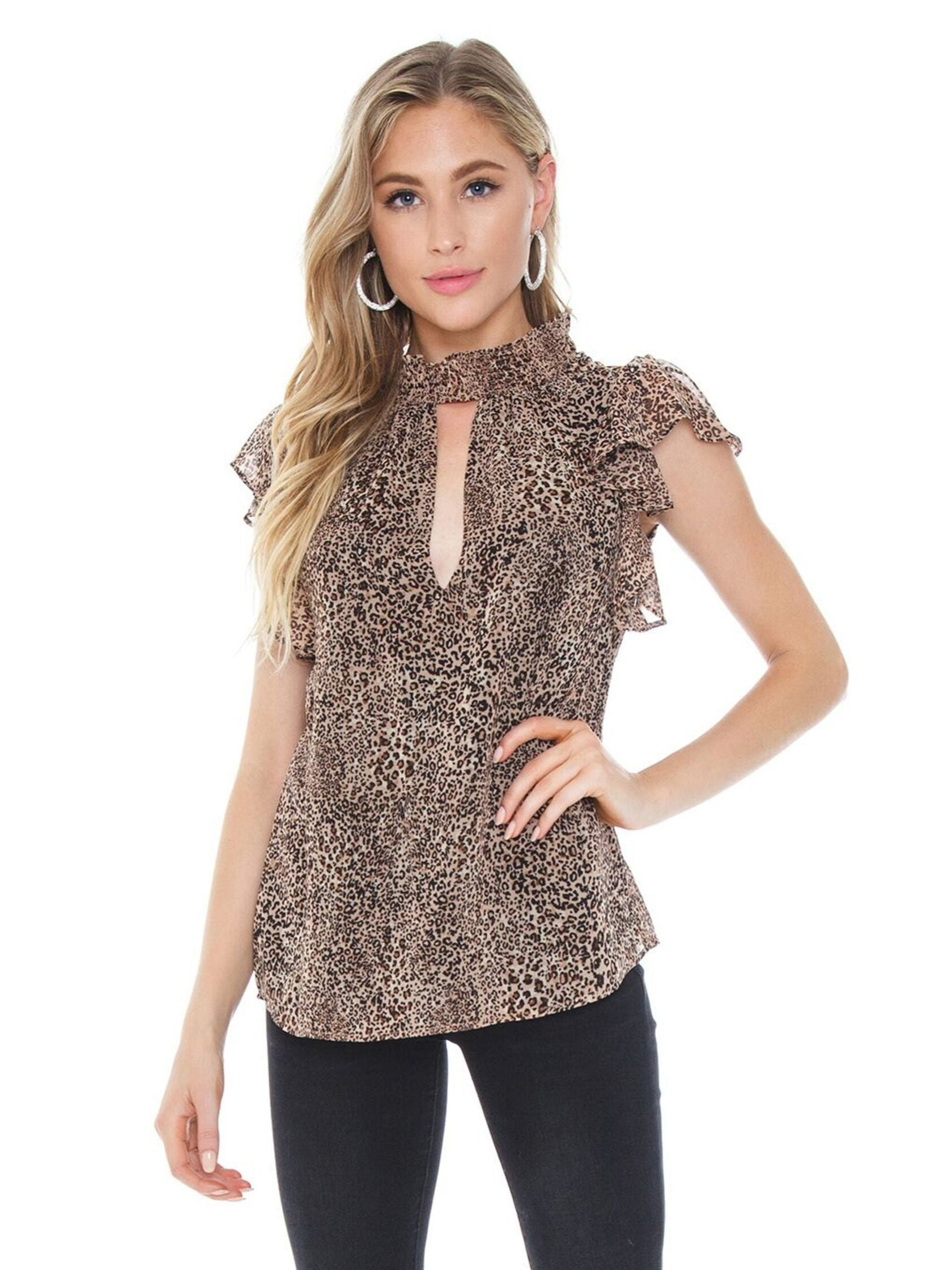 Woman wearing a top rental from 1.STATE called Leopard Muse Smocked Neck Keyhole Blouse