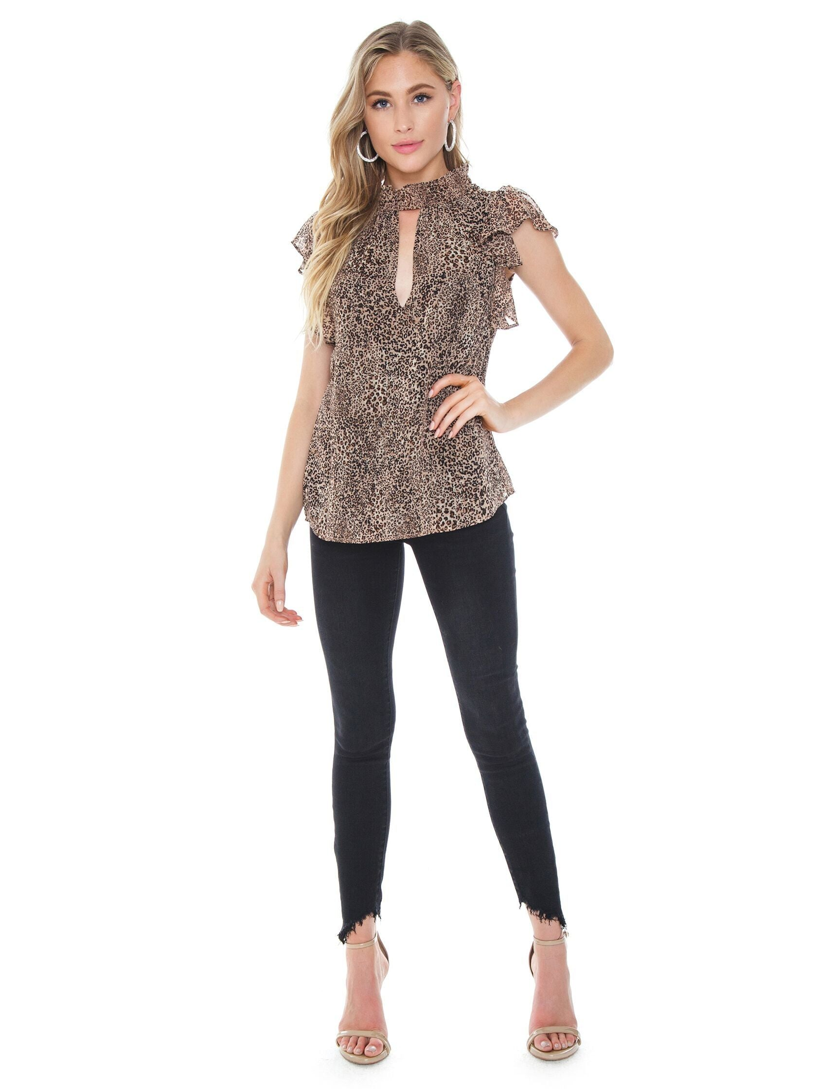 Girl wearing a top rental from 1.STATE called Leopard Muse Smocked Neck Keyhole Blouse