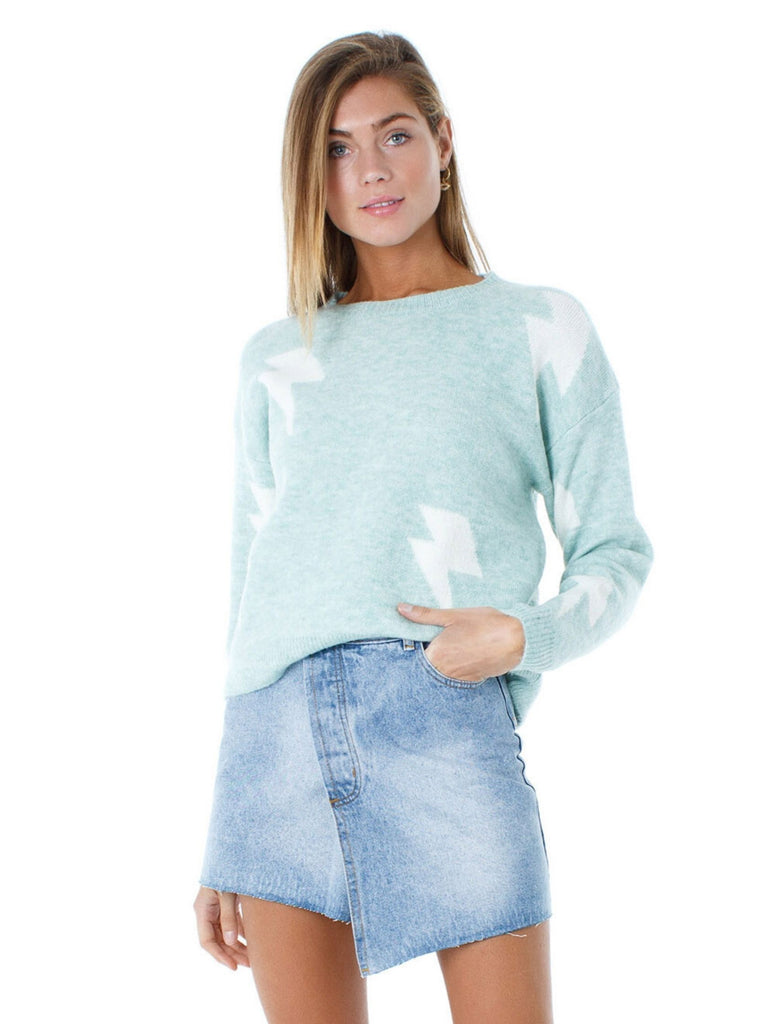 Girl wearing a sweater rental from FashionPass called Mahi Drawstring Top