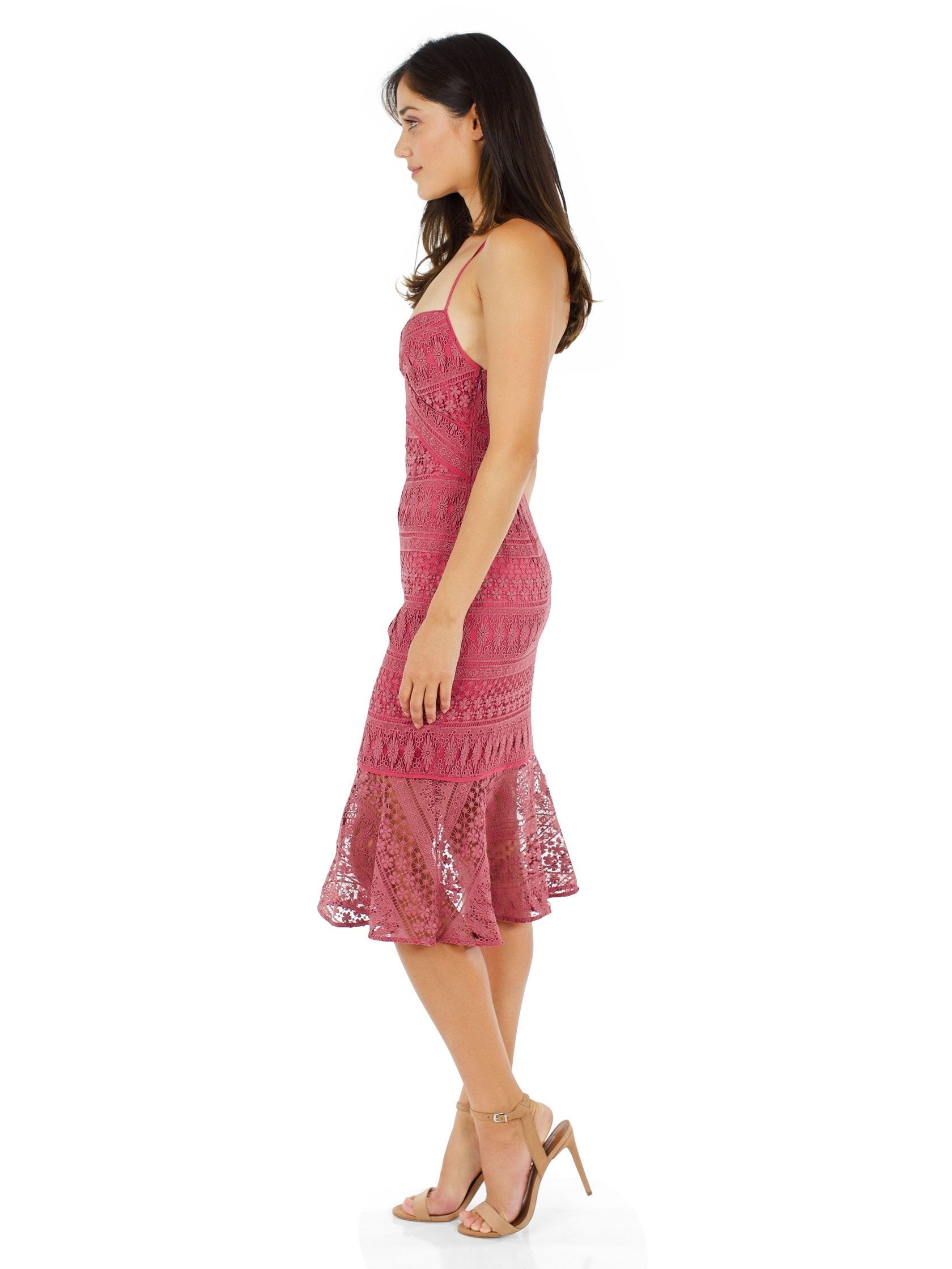 Woman wearing a dress rental from LIKELY called Darby Dress