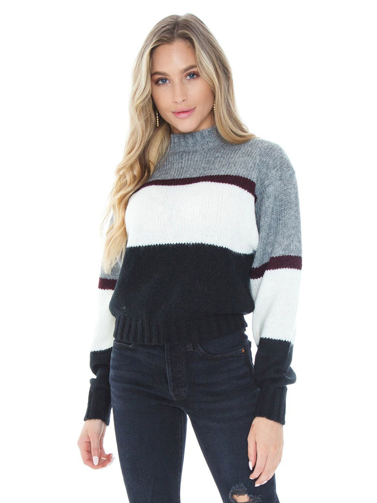 Women wearing a sweater rental from REBECCA MINKOFF called Liliana Striped Sweater