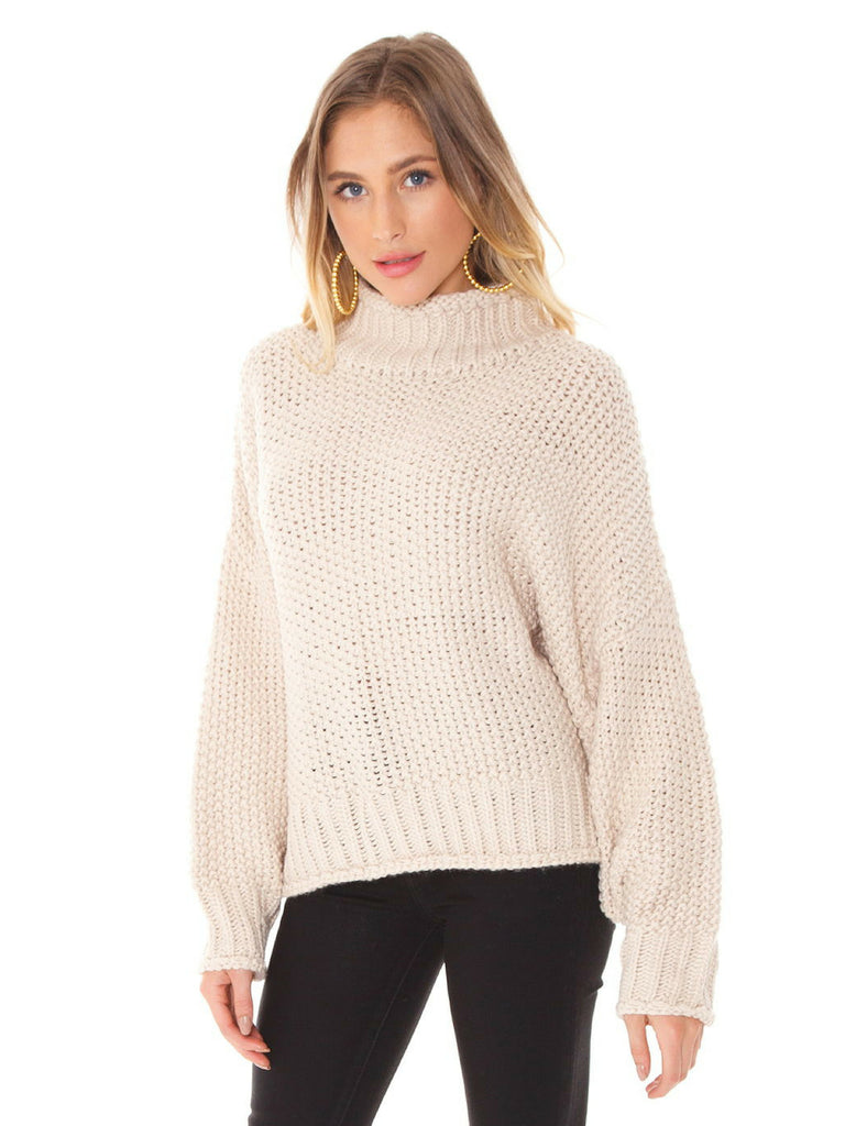 Women wearing a sweater rental from FashionPass called Flare Sweater