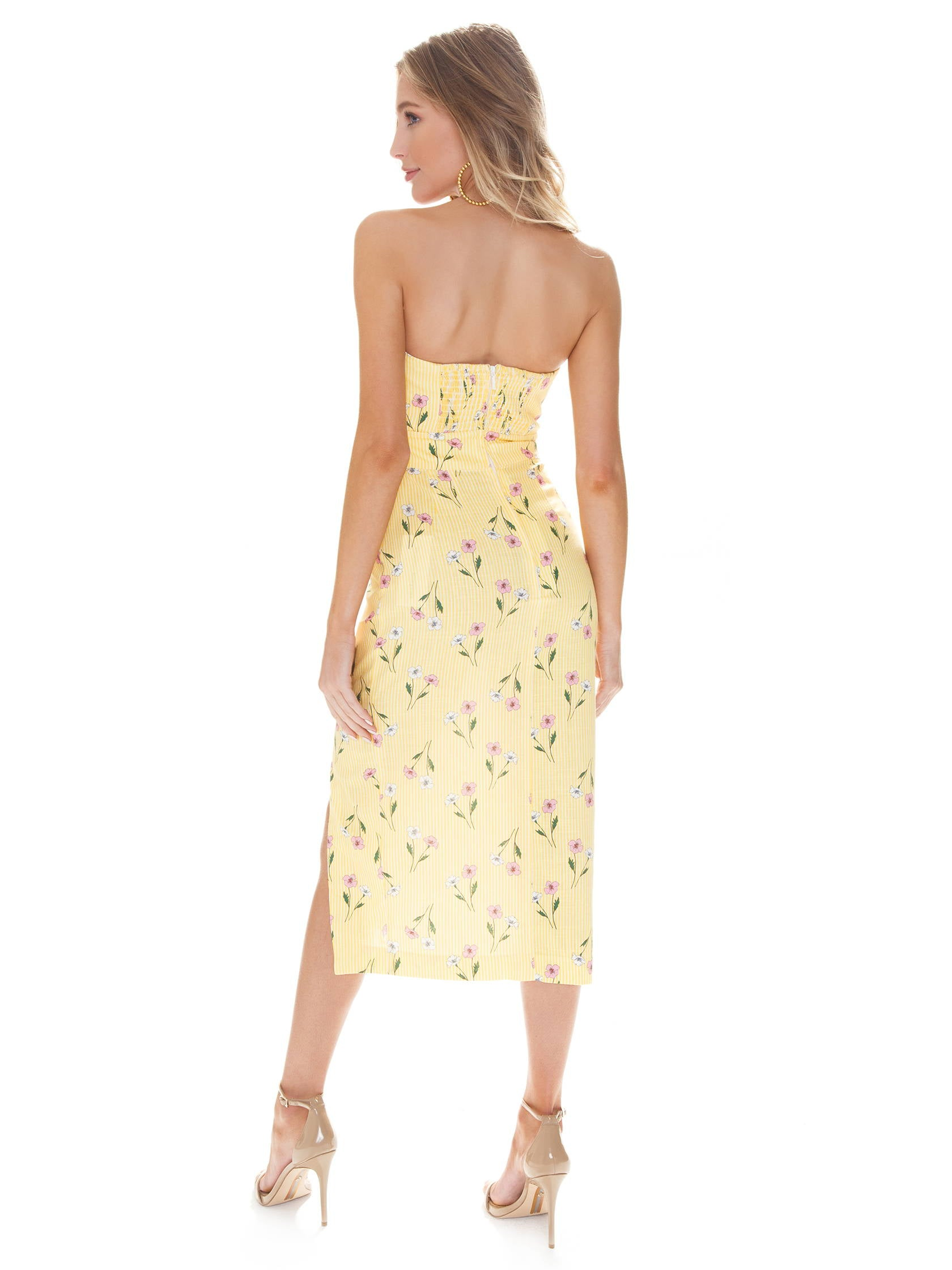 Women wearing a dress rental from Finders Keepers called Limoncello Dress