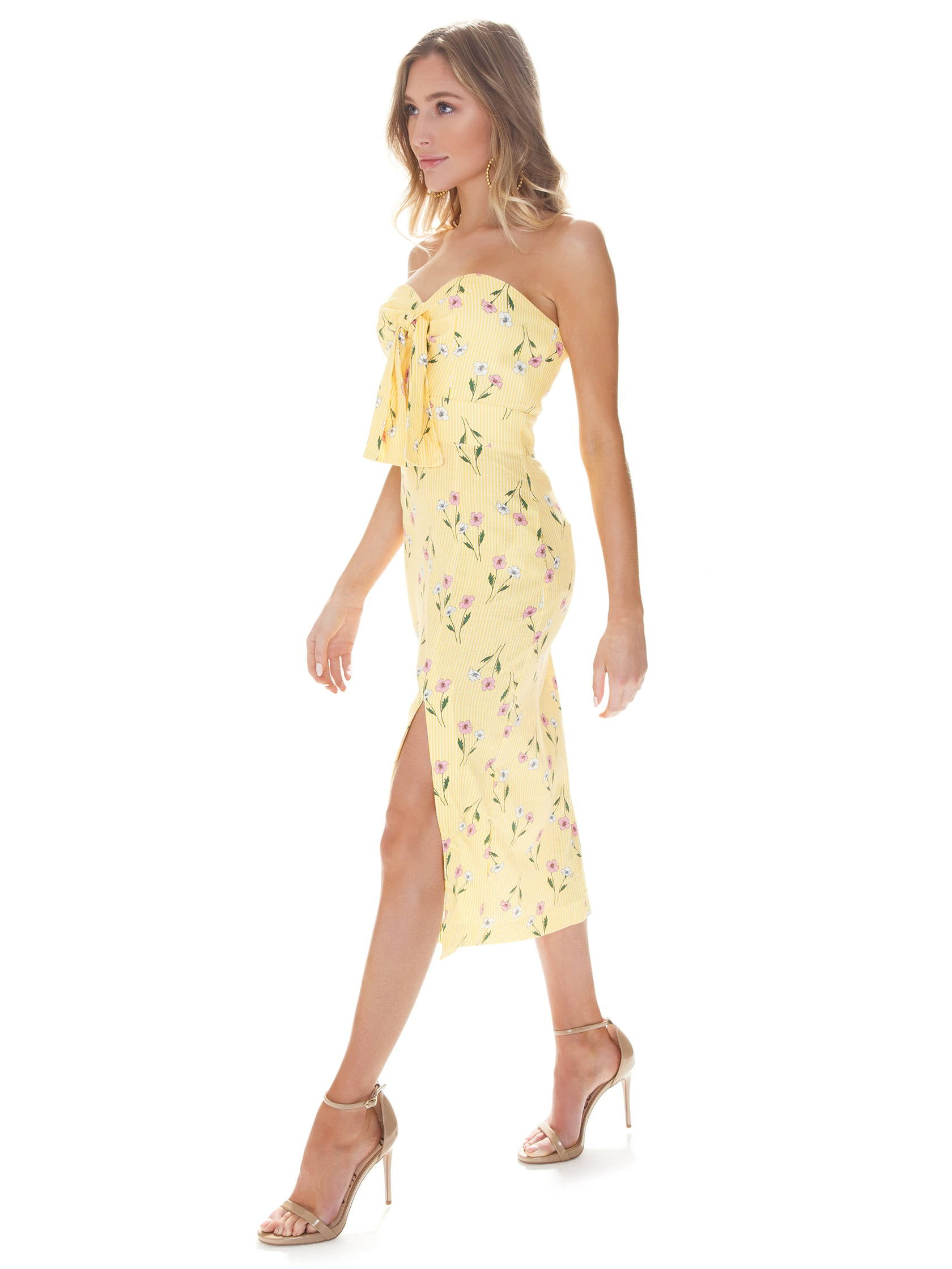 Woman wearing a dress rental from Finders Keepers called Limoncello Dress