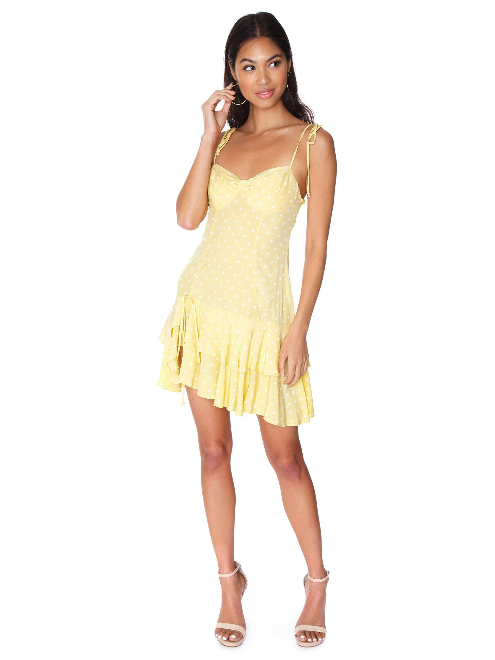 Girl outfit in a dress rental from For Love & Lemons called Limoncello Tiered Ruffle Dress