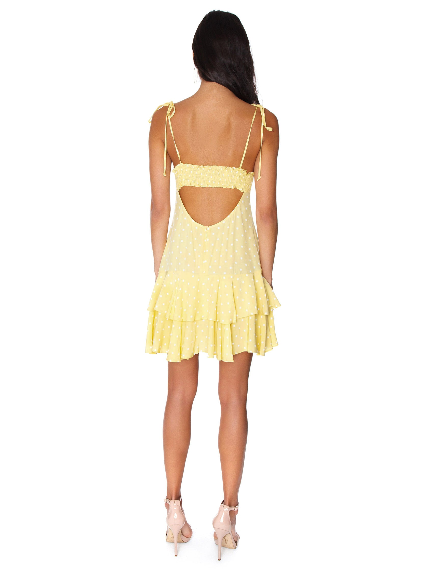 Women wearing a dress rental from For Love & Lemons called Limoncello Tiered Ruffle Dress