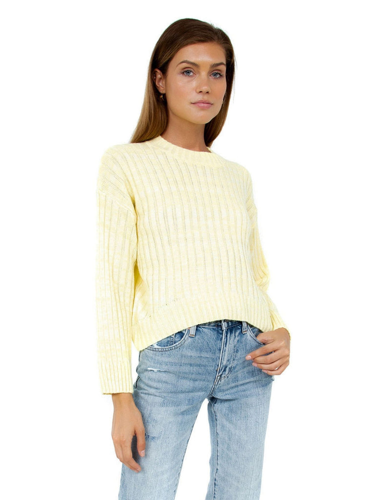Women outfit in a sweater rental from Line & Dot called Jasper Fringe Sweater