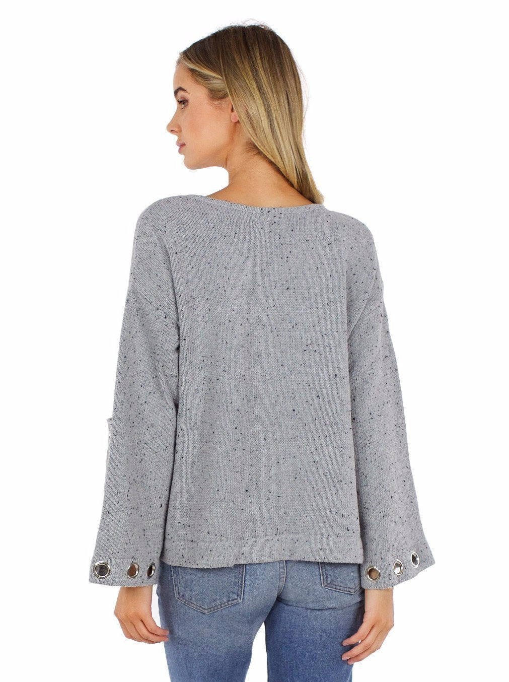 Woman wearing a sweater rental from Line & Dot called Cerc Grommet Cardi