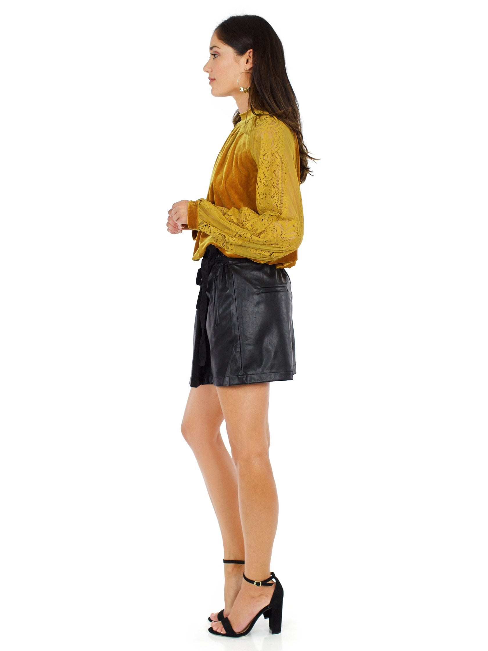 Woman wearing a shorts rental from Line & Dot called Daine Skort