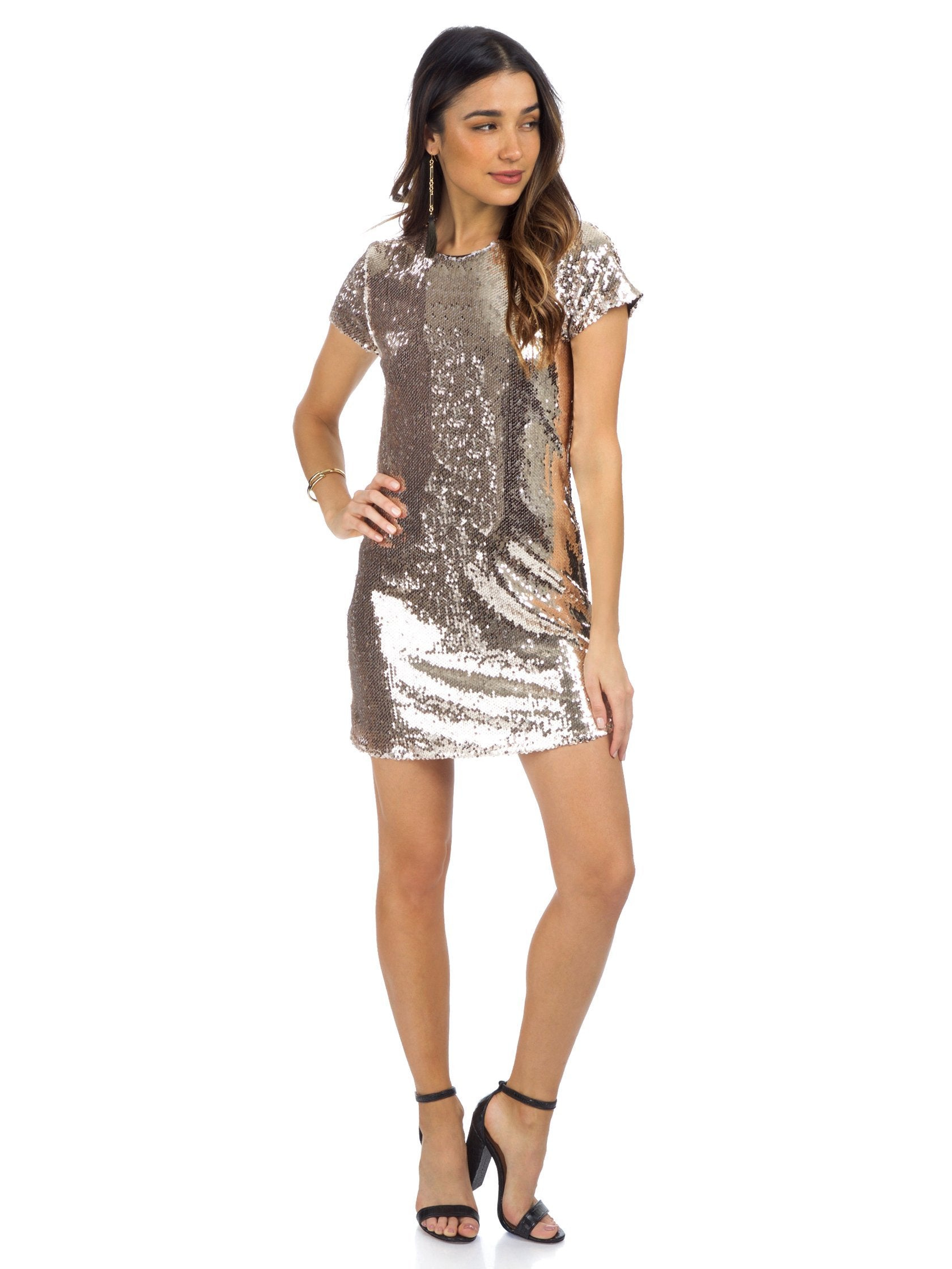 Woman wearing a dress rental from Line & Dot called Soleil Sequin Dress