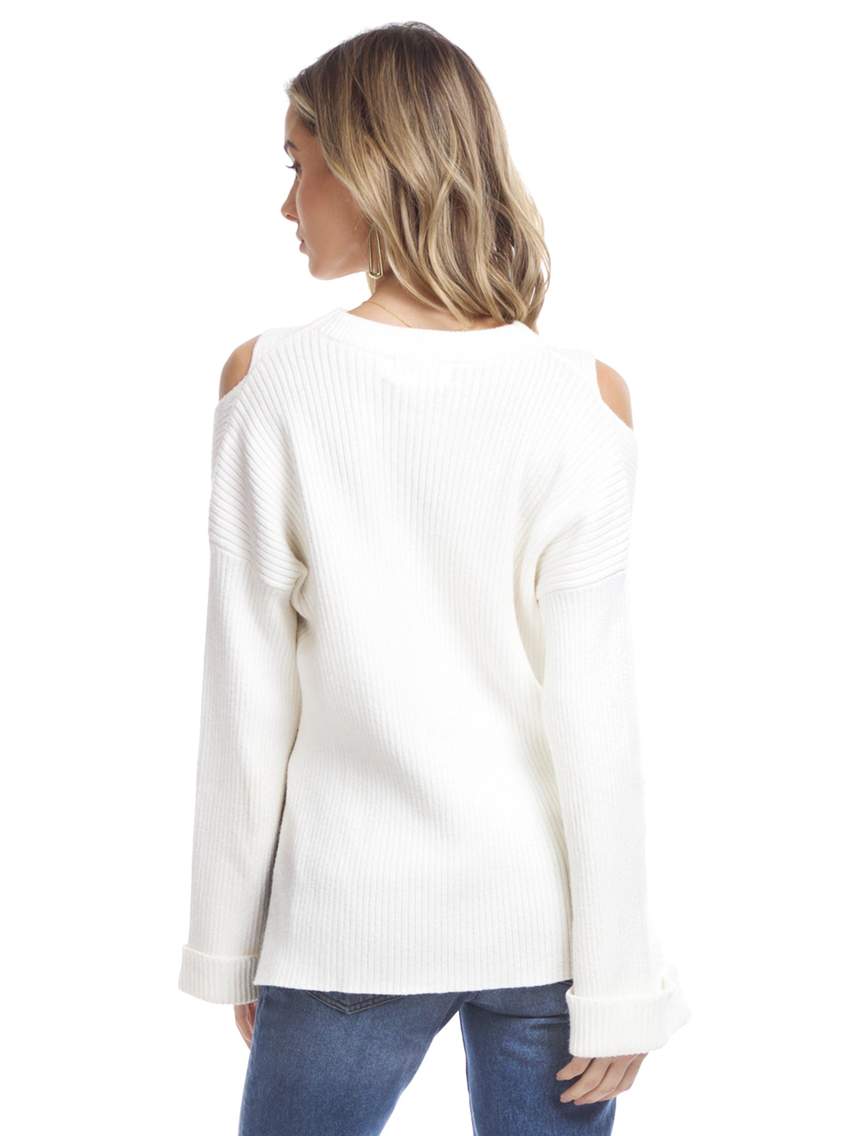 Women outfit in a sweater rental from Line & Dot called Trou Cold Shoulder Sweater