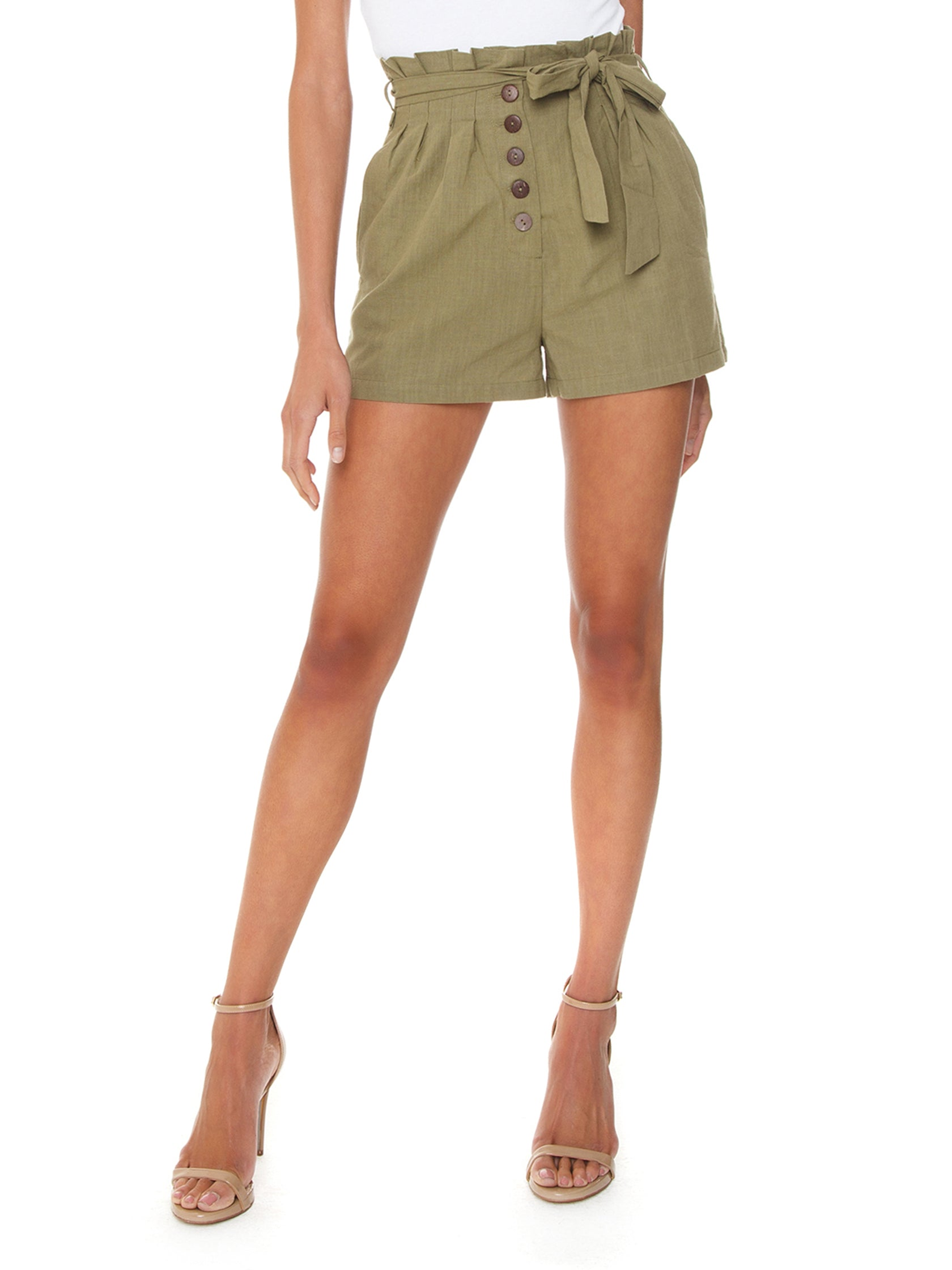 Woman wearing a shorts rental from MINKPINK called Linen Paperbag Shorts