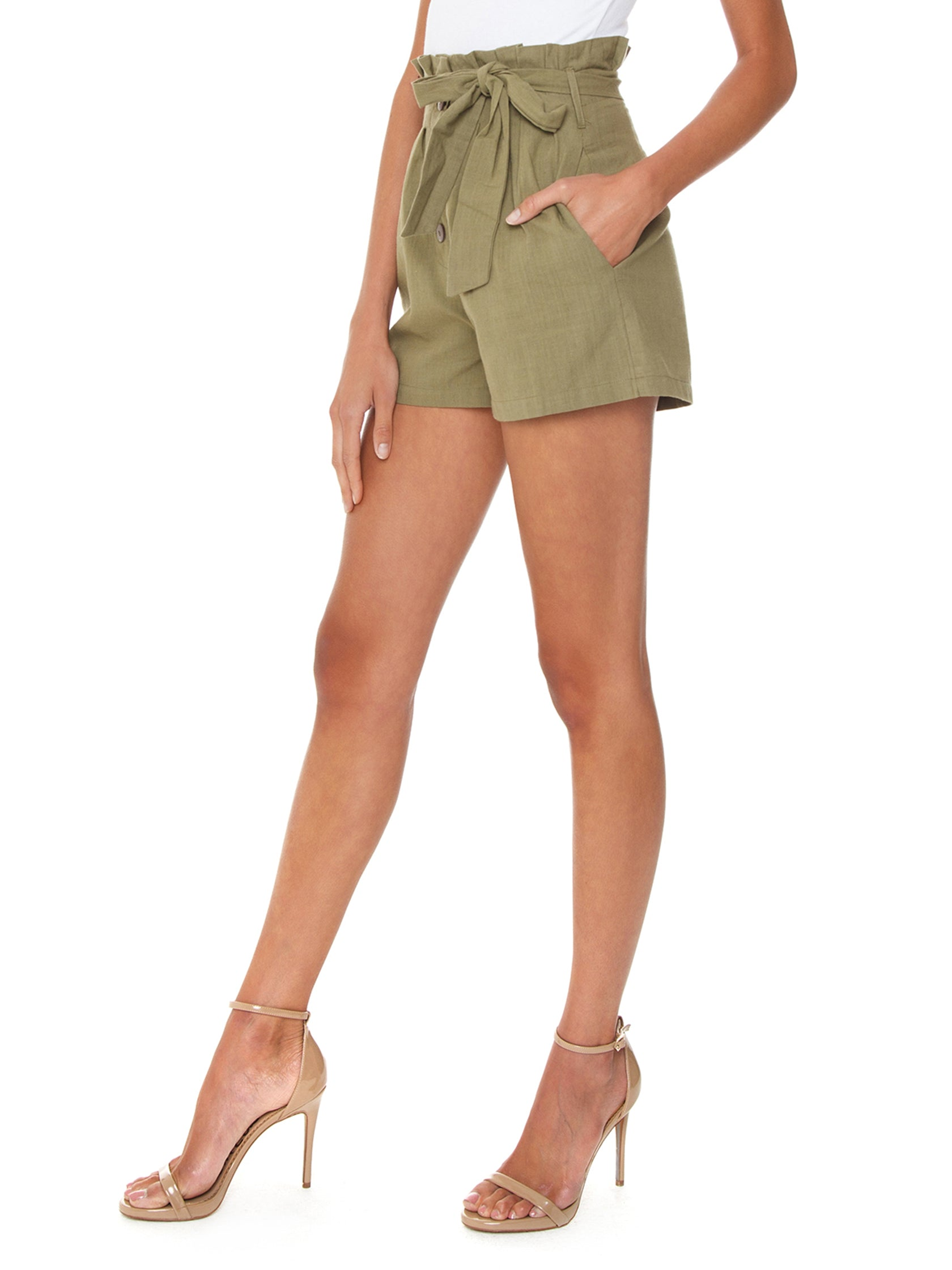 Women wearing a shorts rental from MINKPINK called Linen Paperbag Shorts