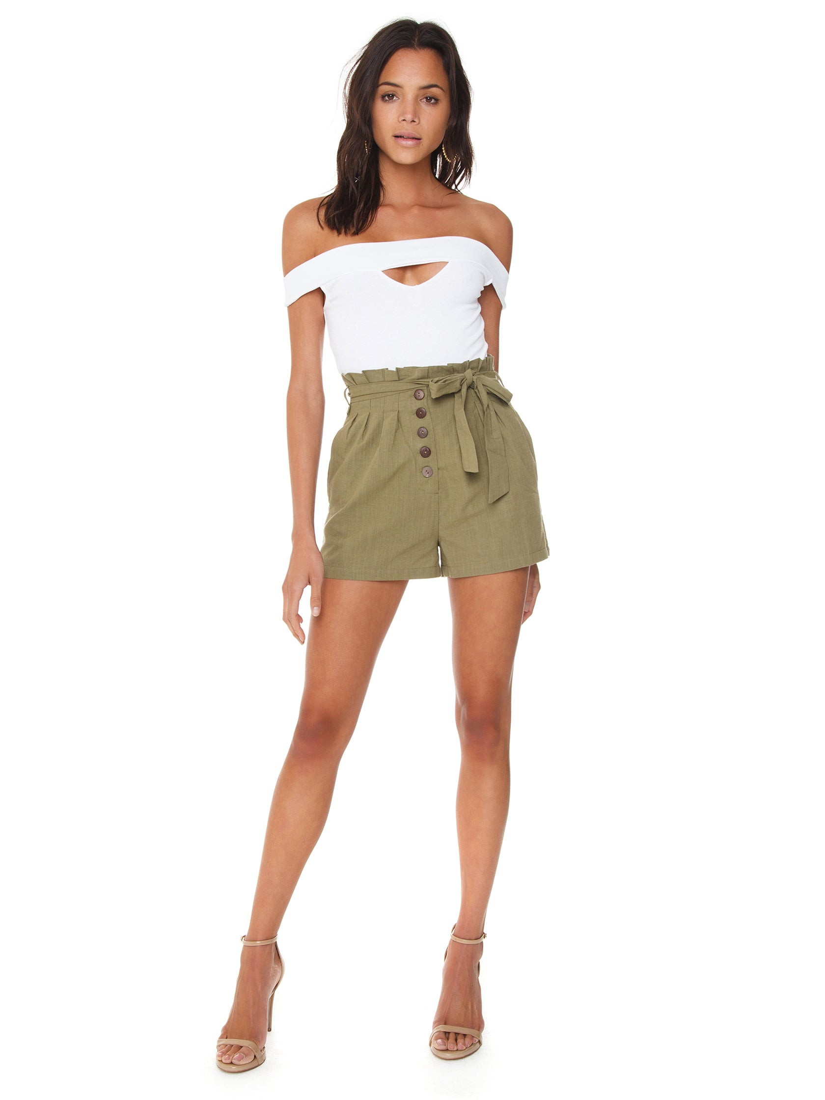 Girl wearing a shorts rental from MINKPINK called Linen Paperbag Shorts