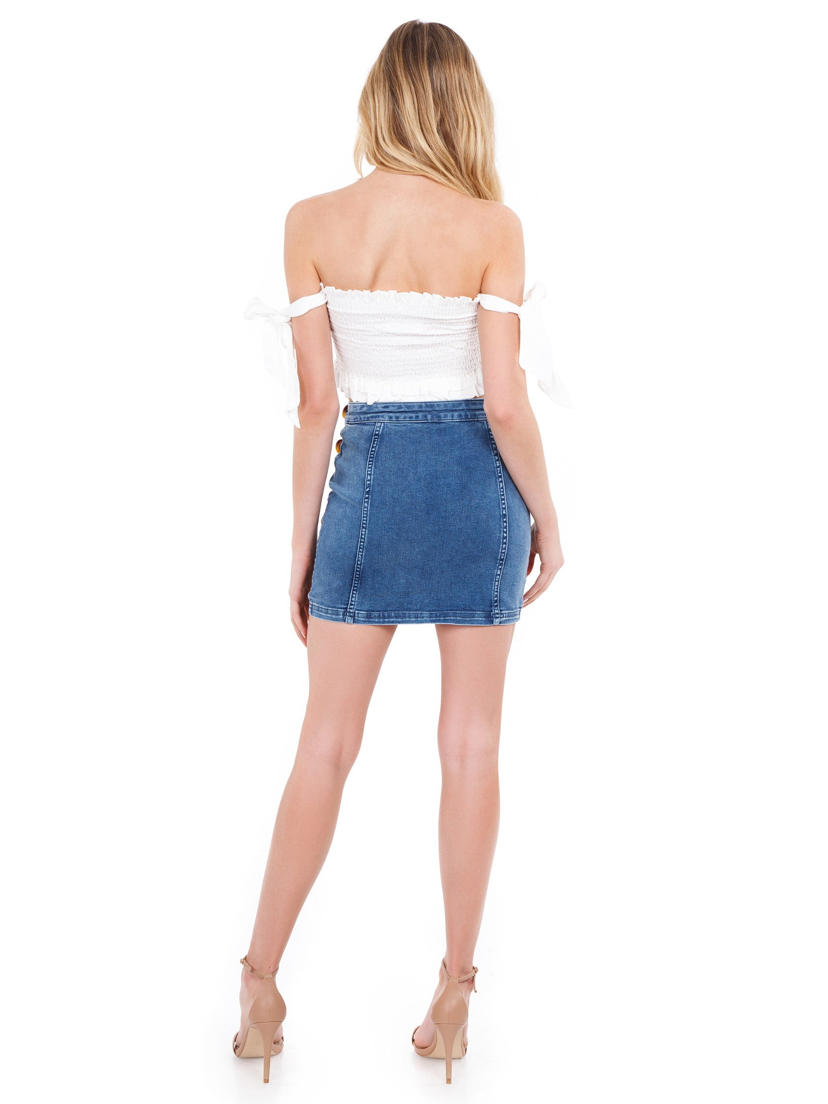 Women wearing a skirt rental from Free People called Little Daisies Denim Mini Skirt