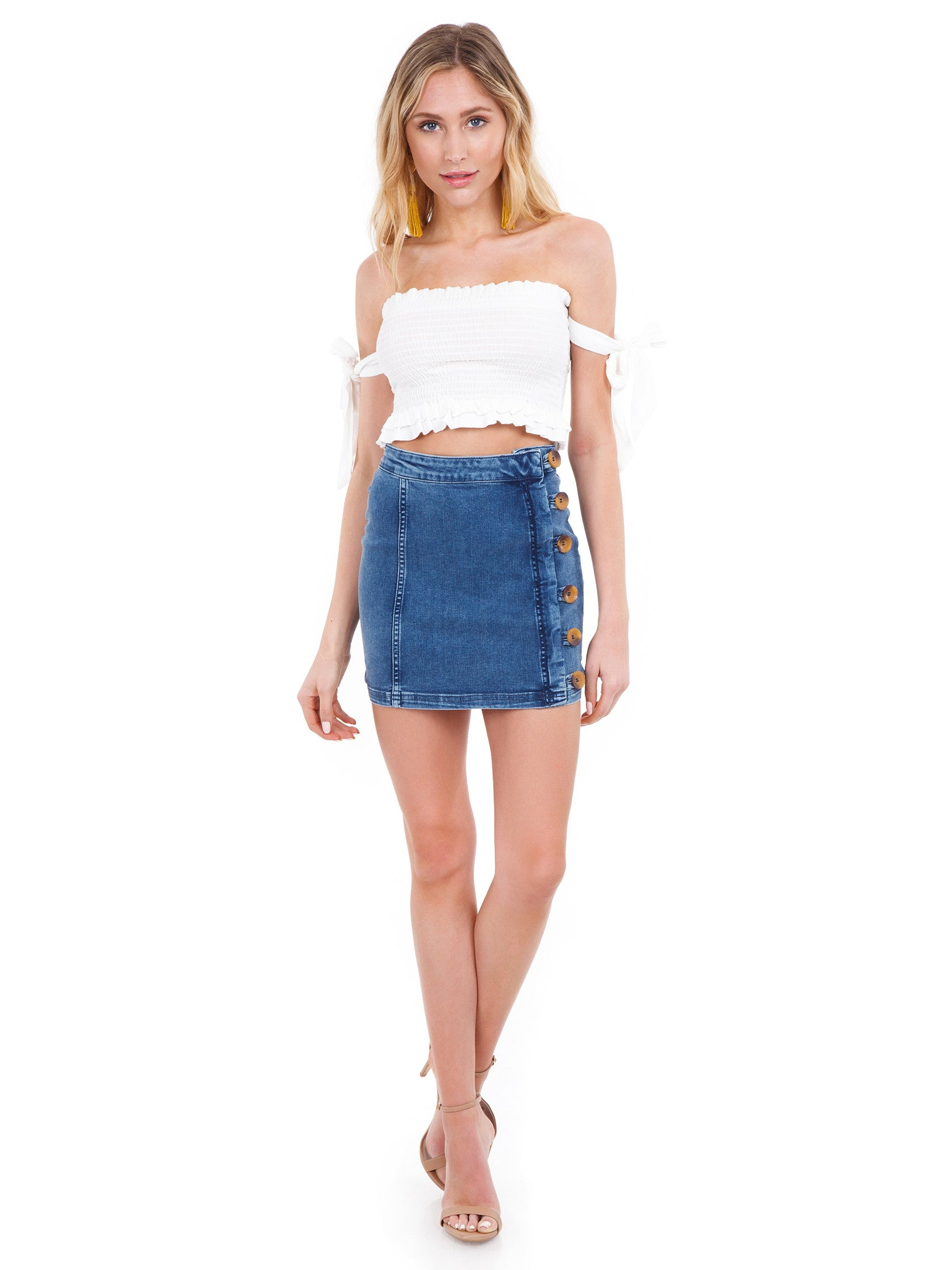 Girl outfit in a skirt rental from Free People called Little Daisies Denim Mini Skirt
