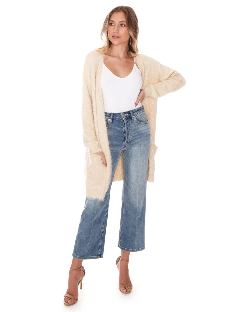 Women wearing a cardigan rental from FashionPass called Warm Thoughts Wubby Jacket
