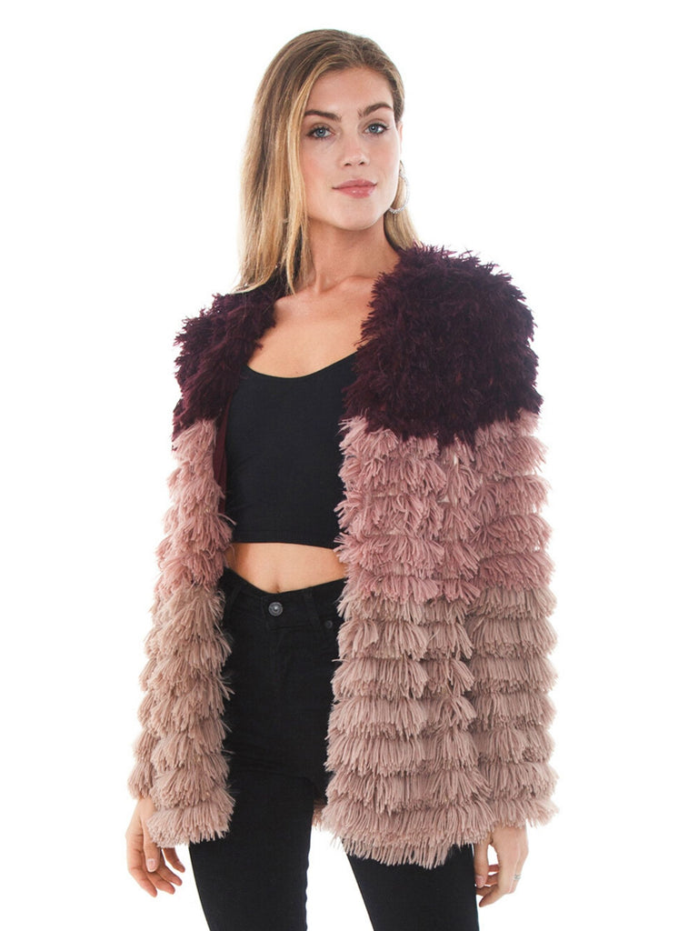 Woman wearing a jacket rental from MINKPINK called Fab Moment Faux Fur Jacket