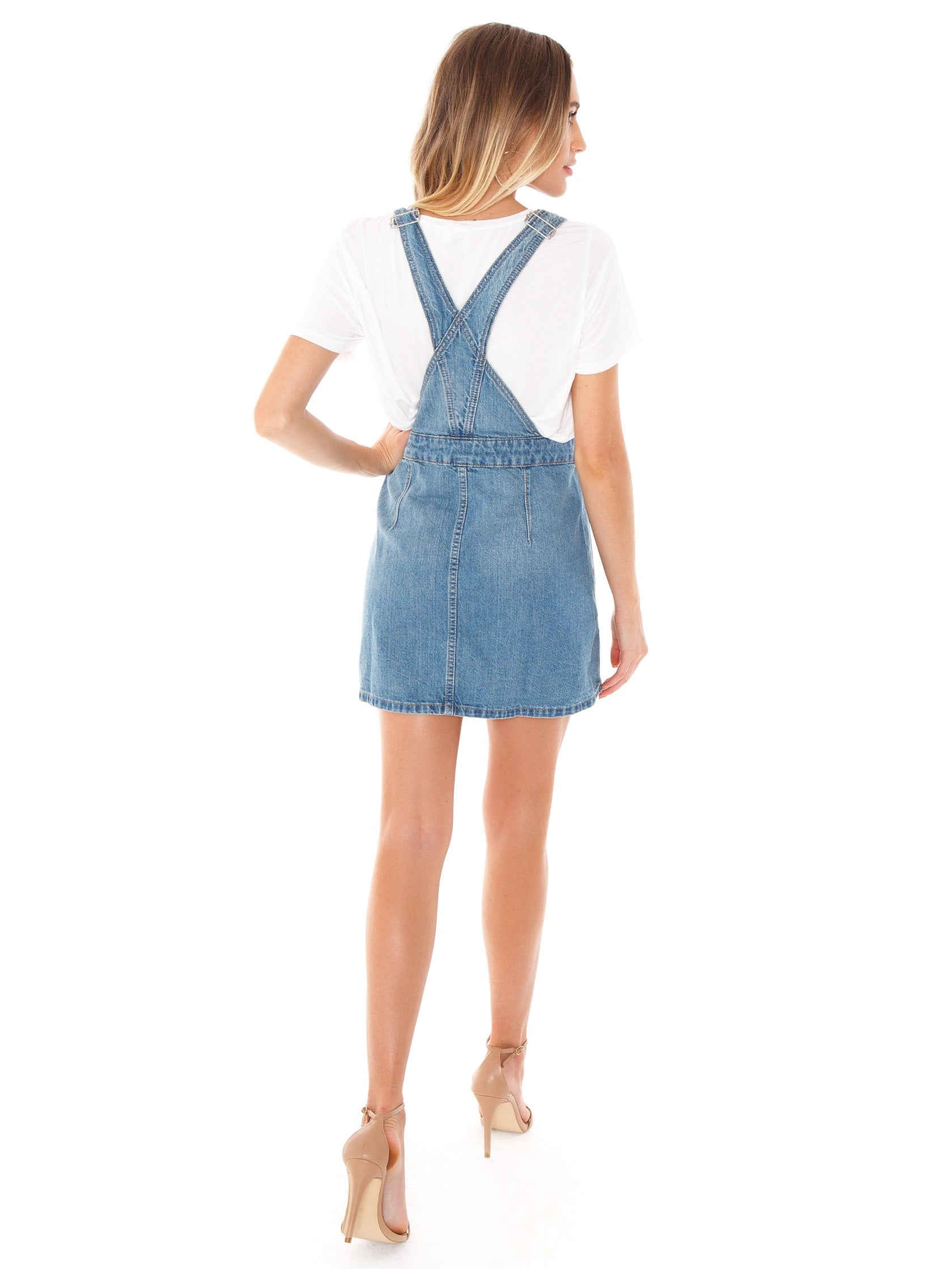 174a6430a7 Women wearing a denim rental from Free People called Louise Denim Skirtall