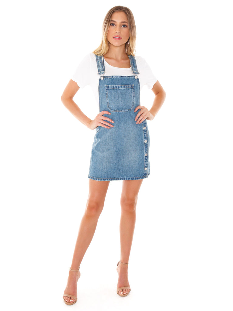 Woman wearing a denim rental from Free People called Bachelorette Mini Dress
