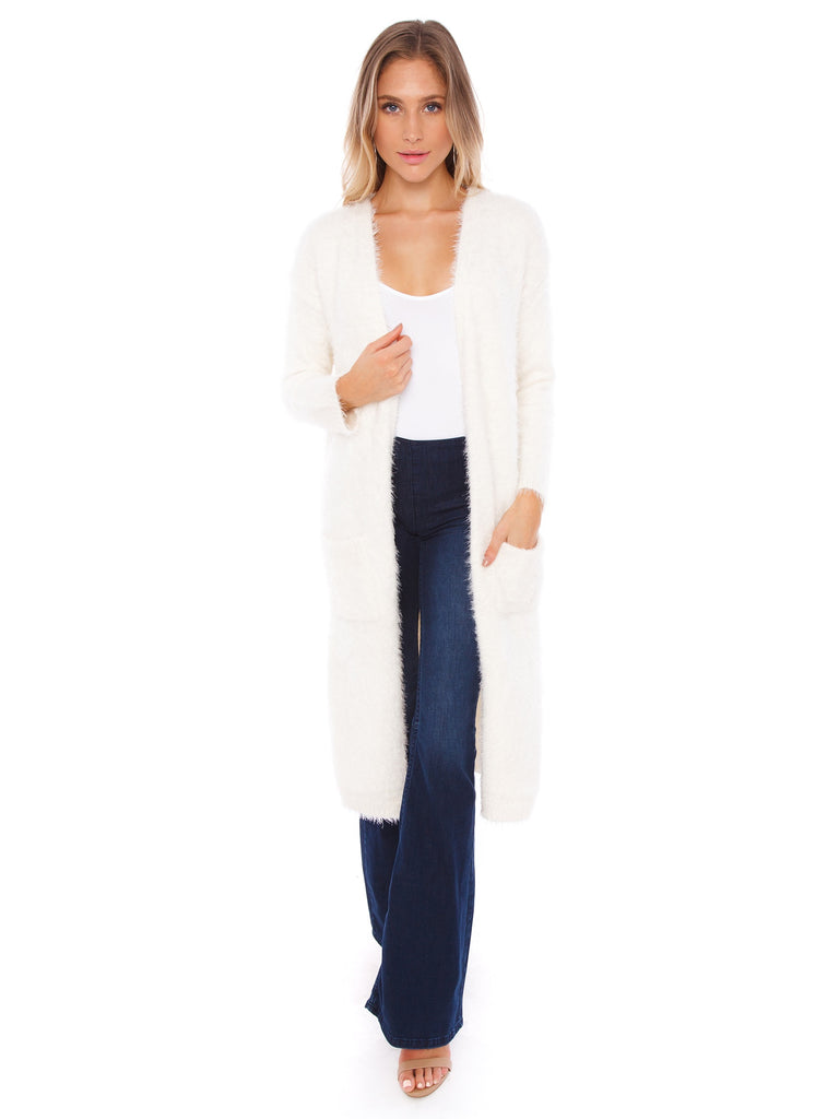 Woman wearing a cardigan rental from BB Dakota called Warm Thoughts Wubby Jacket