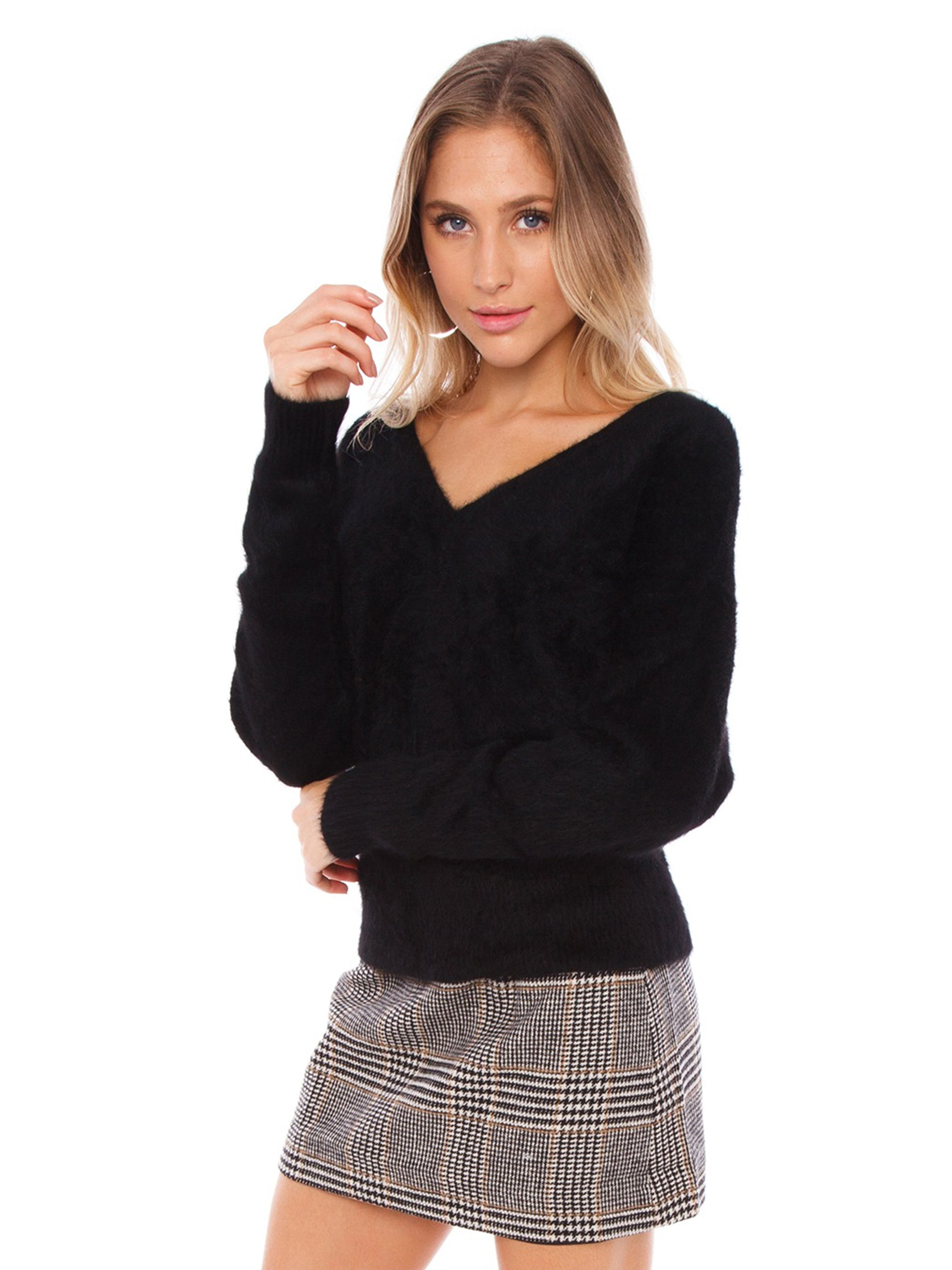 Women wearing a sweater rental from SAGE THE LABEL called Lover Lay Down Sweater