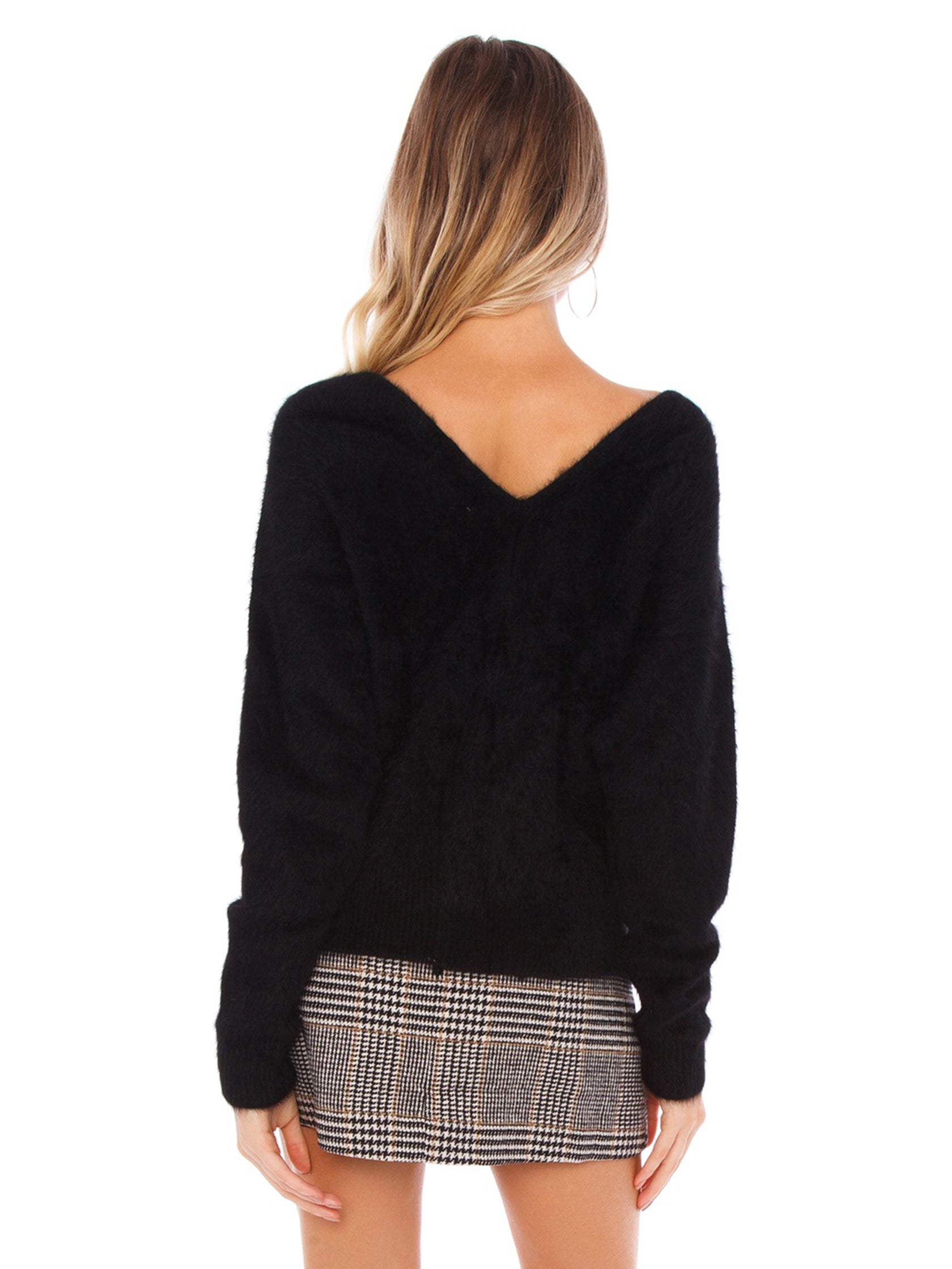 Women outfit in a sweater rental from SAGE THE LABEL called Lover Lay Down Sweater