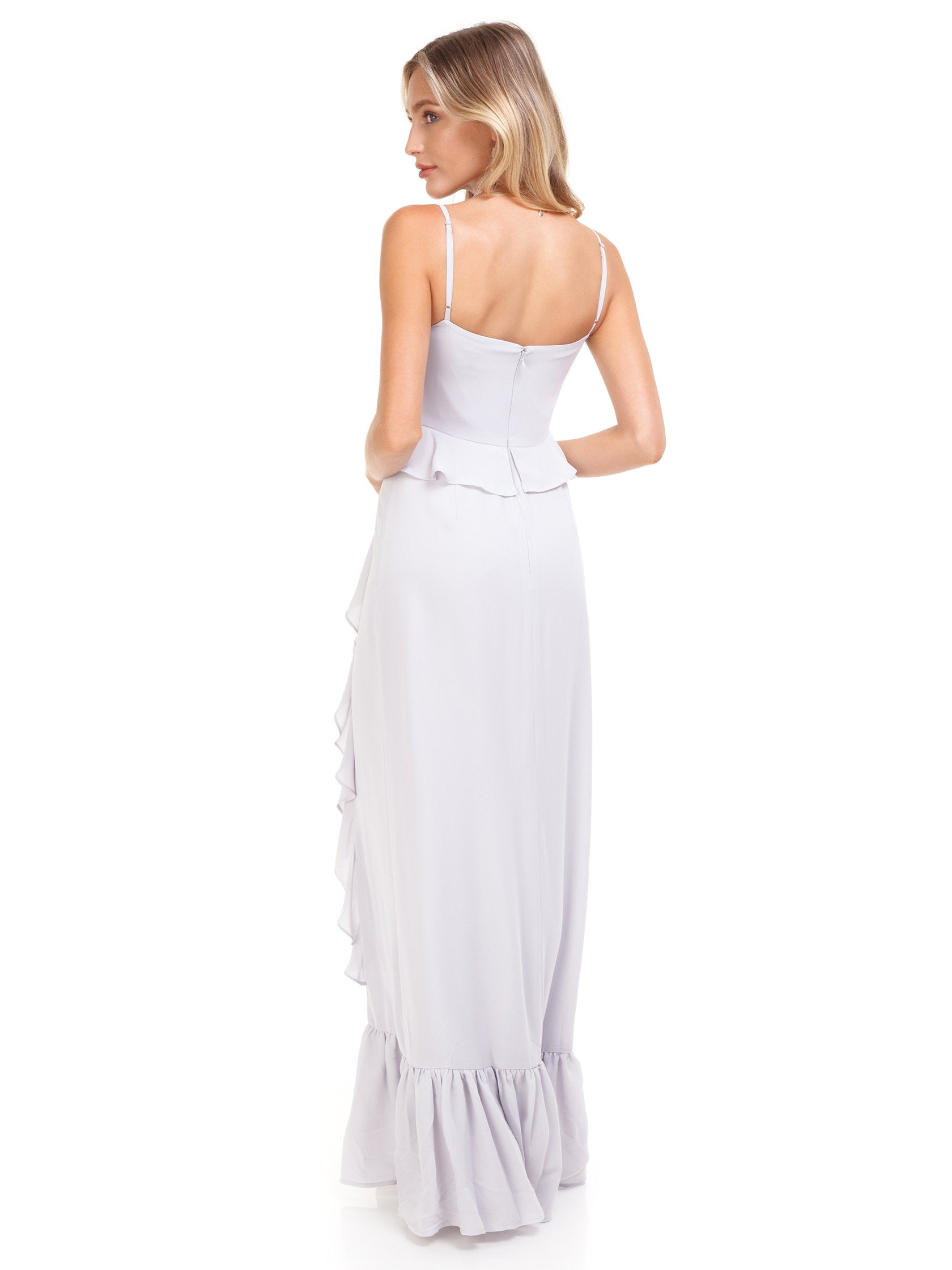 ed03448a2ee6 Women wearing a dress rental from WAYF called Loyal Ruffle Empire Tiered  Maxi
