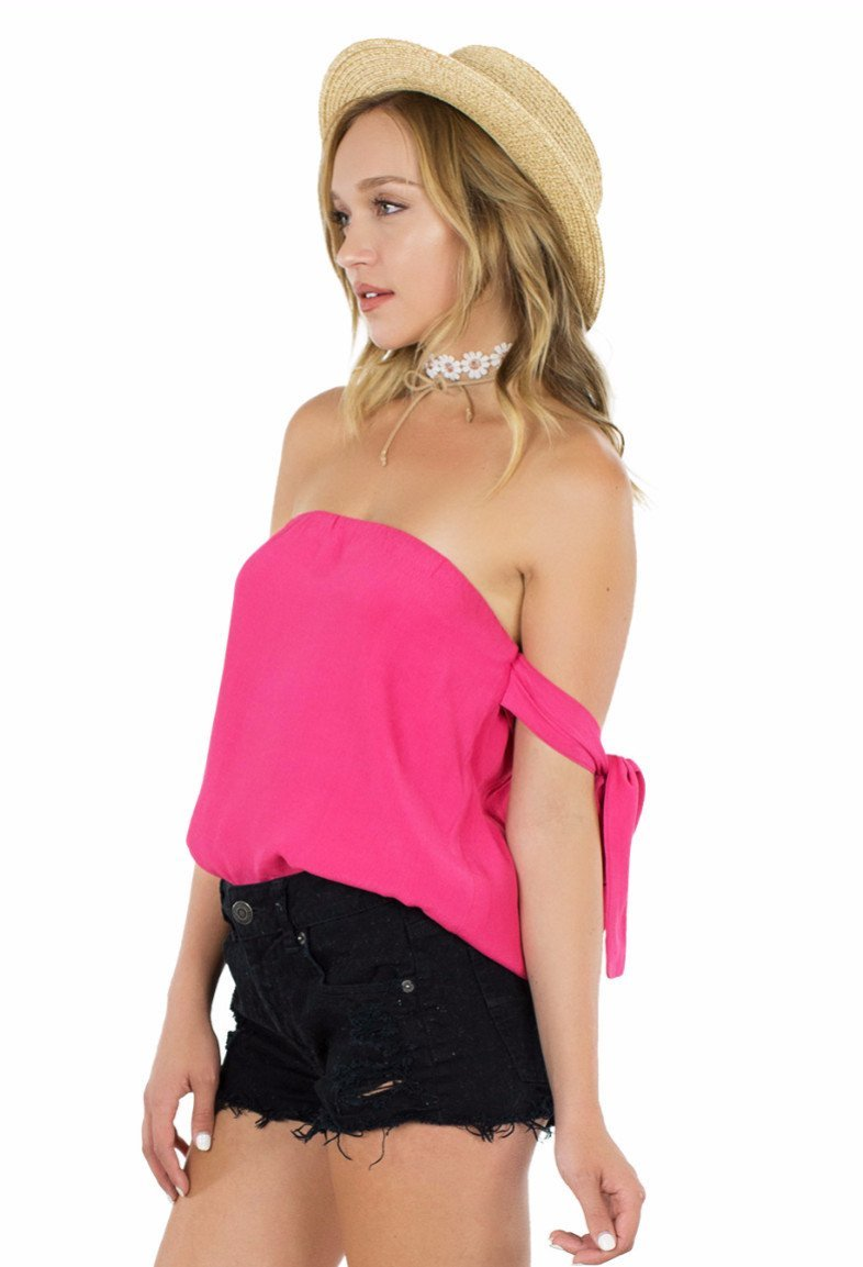 Women wearing a top rental from Lucca Couture called Guava Off Shoulder Tie Sleeve Top