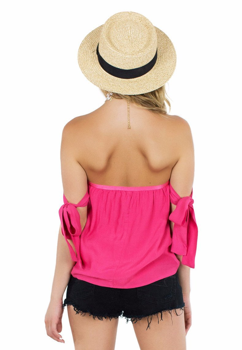 Women outfit in a top rental from Lucca Couture called Guava Off Shoulder Tie Sleeve Top